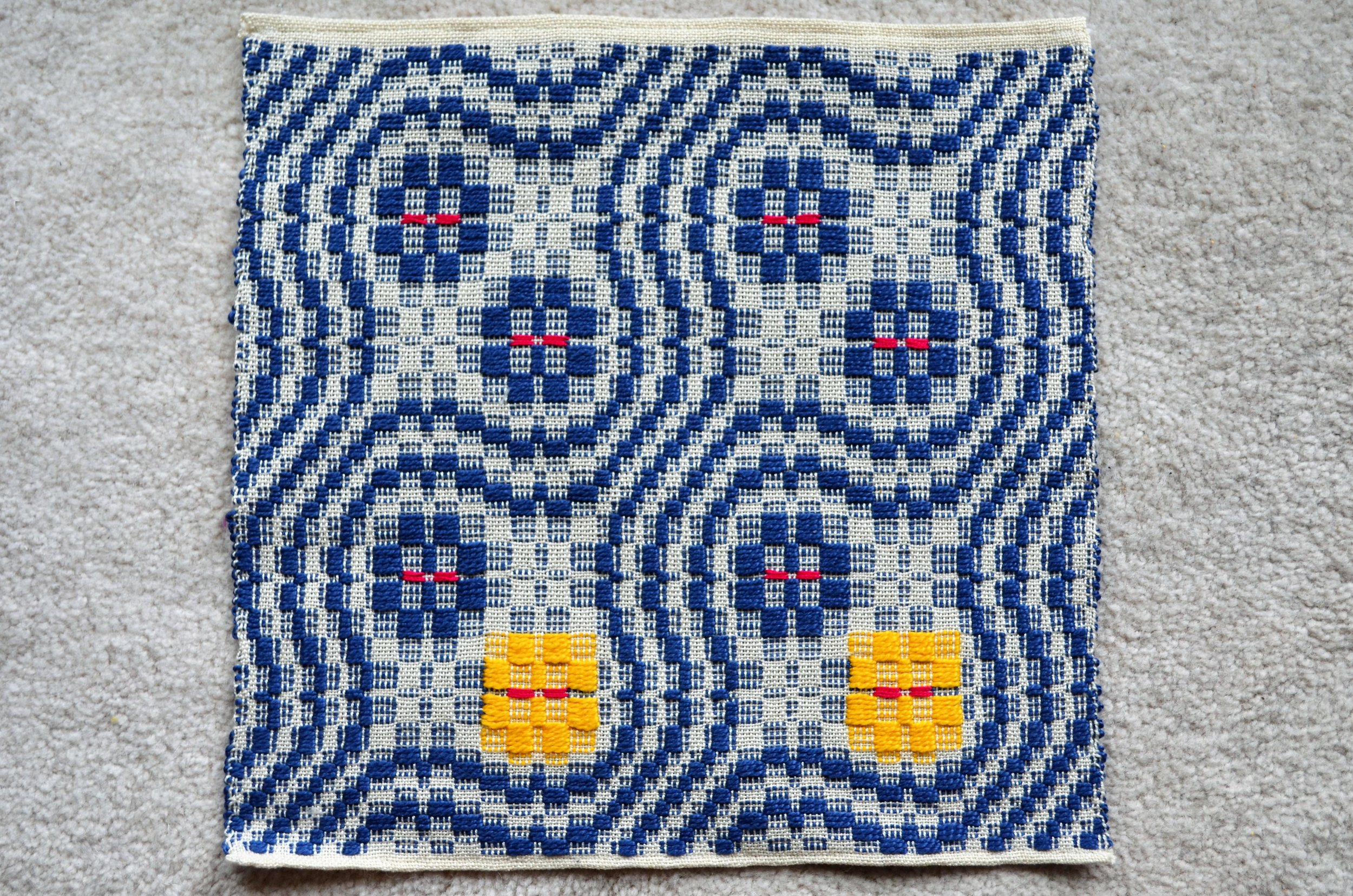 Snail Trail with Yellow Flower weaving / warporweft.com