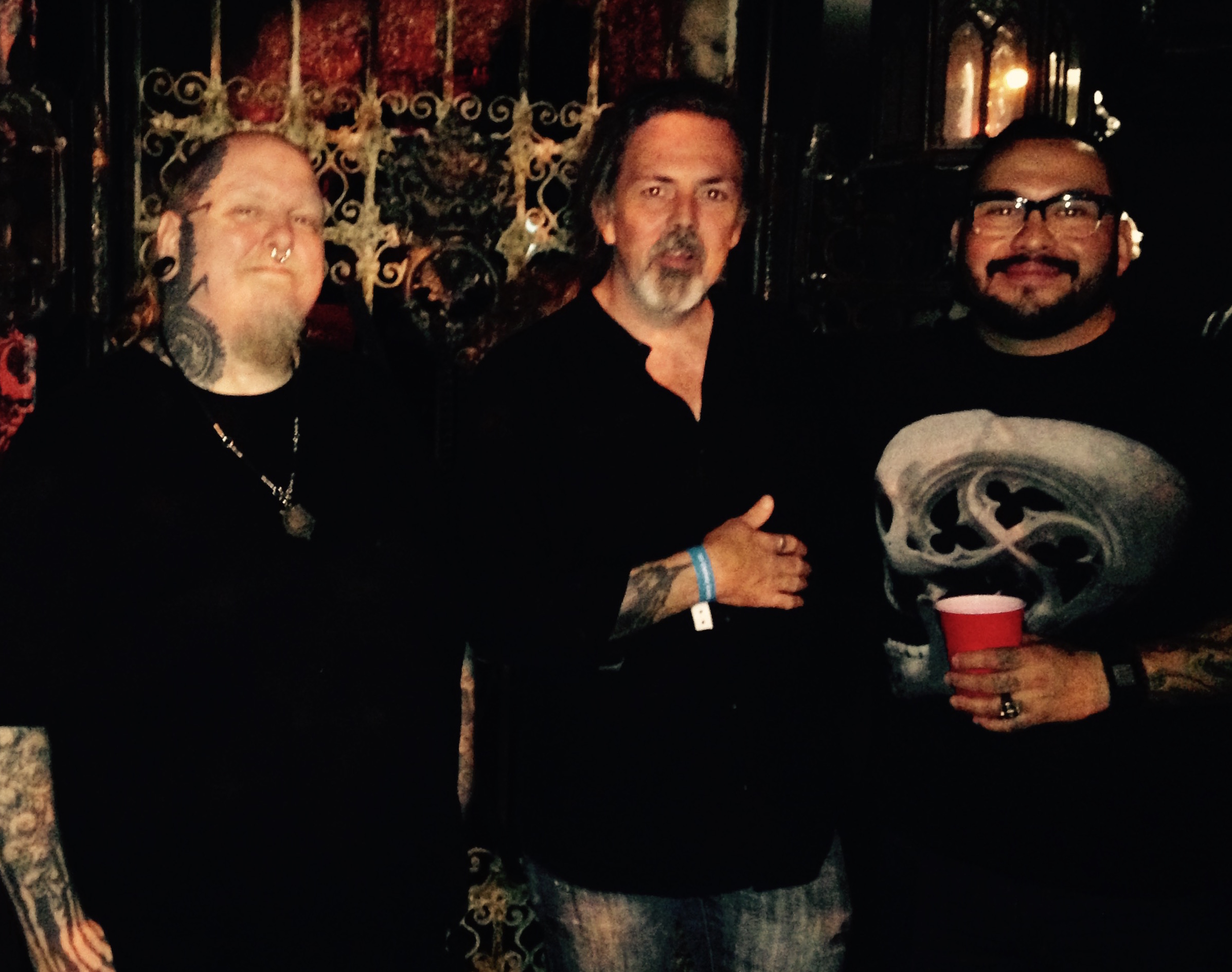 Paul Booth (left), Nikko Hurtado (right) and me. There's more black in this photo than I've ever seen. Good work darkness.