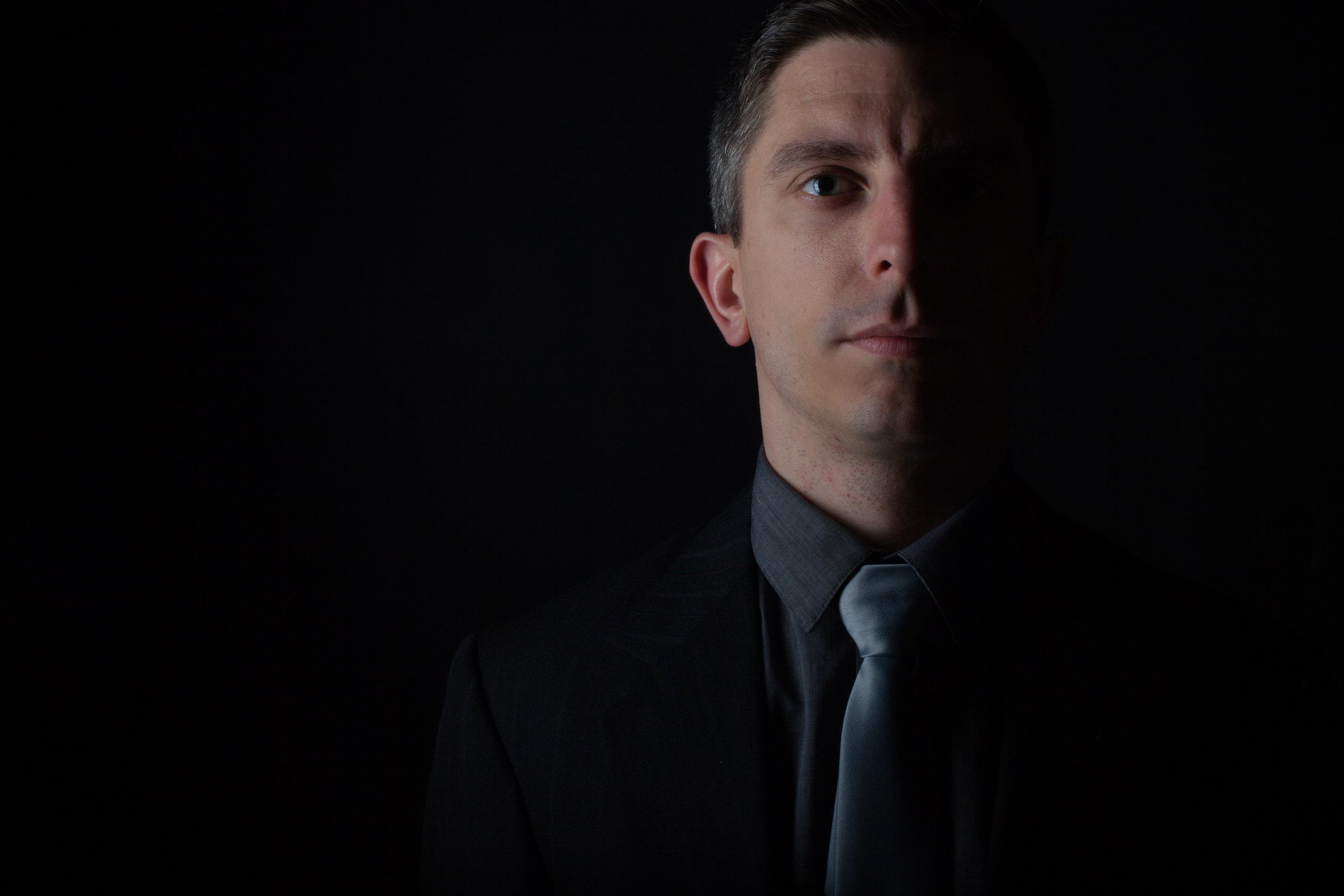 Kevin-J-Cope-Composer-Black-Background-credit-Brian-Mengini.jpg