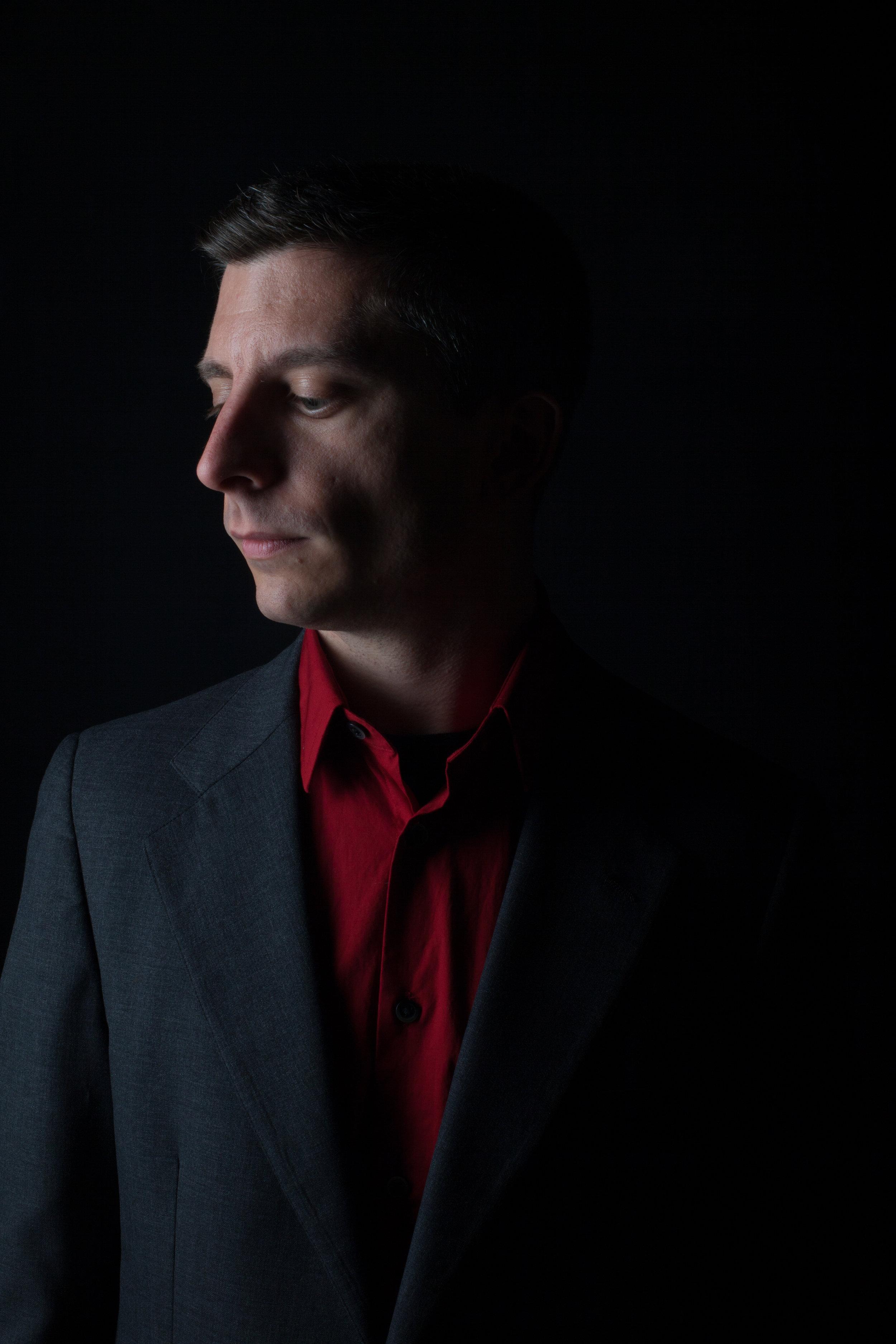 Kevin-J-Cope-Red-Shirt-Sideface-Dark-credit-Brian-Mengini.jpg