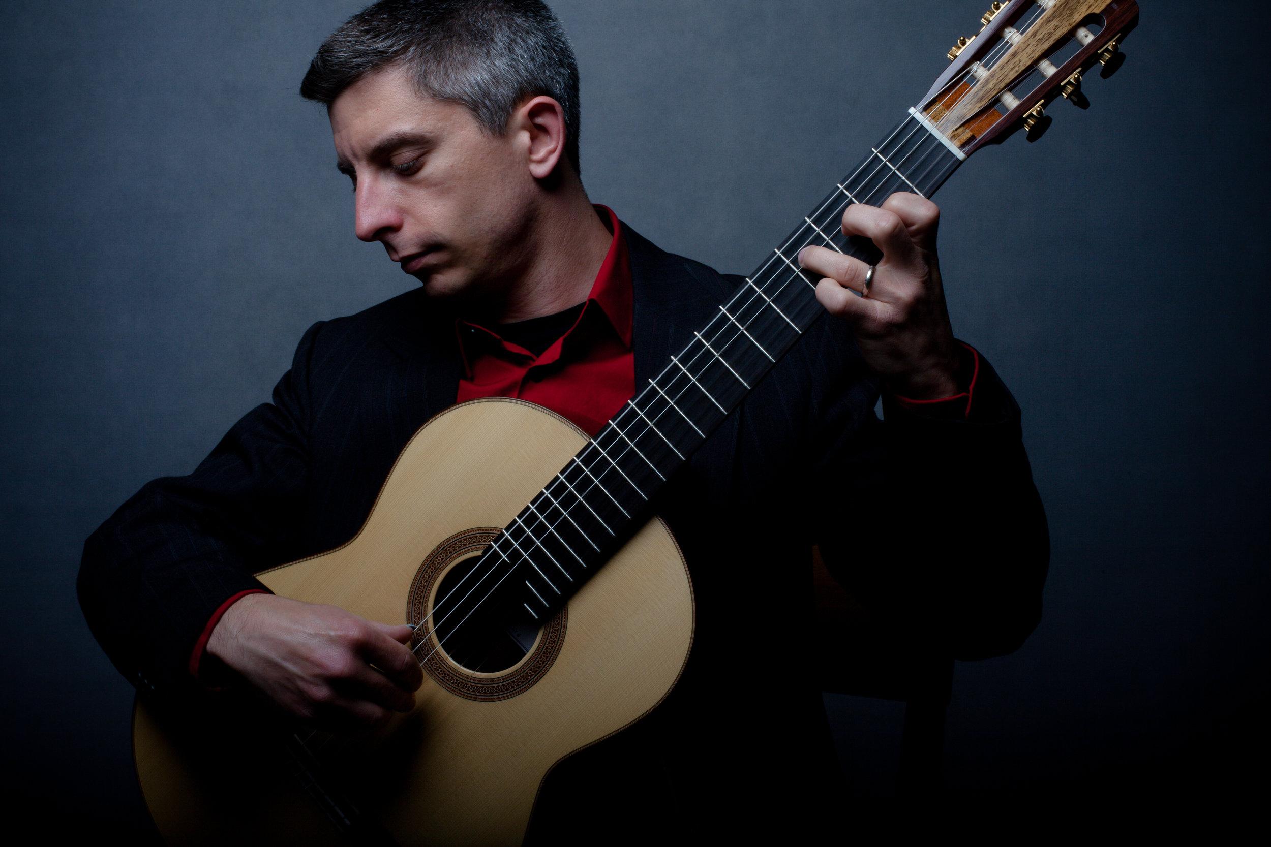 Kevin-J-Cope-playing-Douglass-Scott-Guitar-credit-Brian-Mengini.jpg