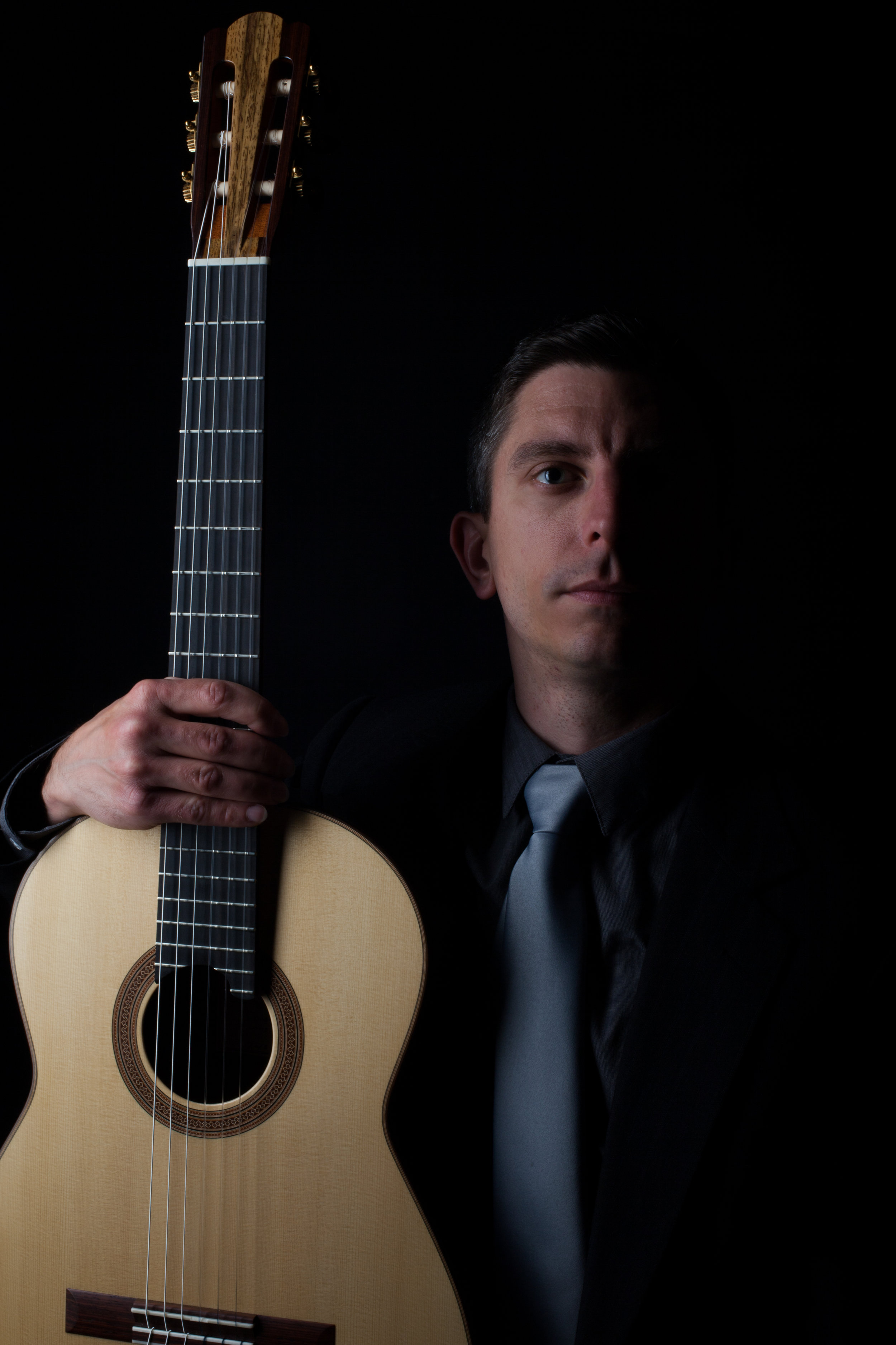 Kevin-J-Cope-Holding-Douglass-Scott-Guitar-credit-Brian-Mengini (2).jpg
