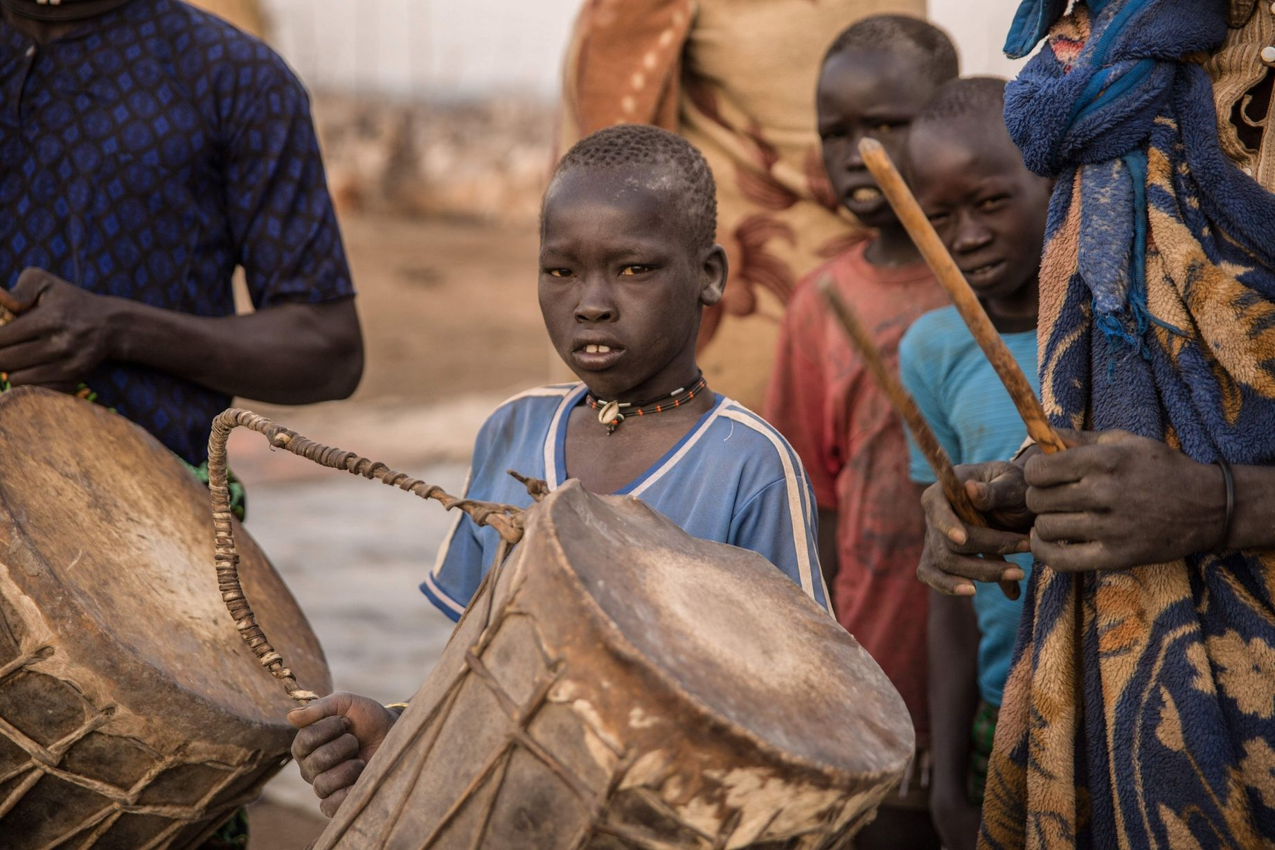 Sudanese-boys-from-Dinka-tribe-hold-inst.jpg