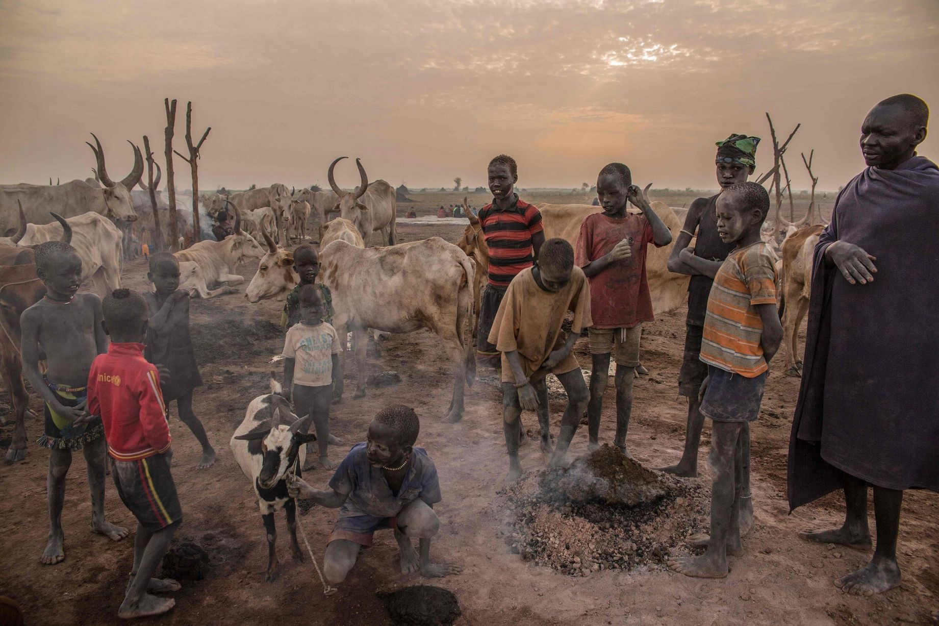 Sudanese-boys-from-Dinka-tribe-gather-ar.jpg