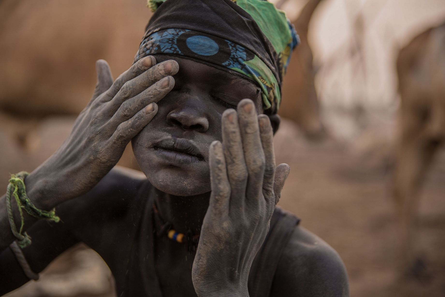 A-Sudanese-boy-from-Dinka-tribe-covers-h.jpg