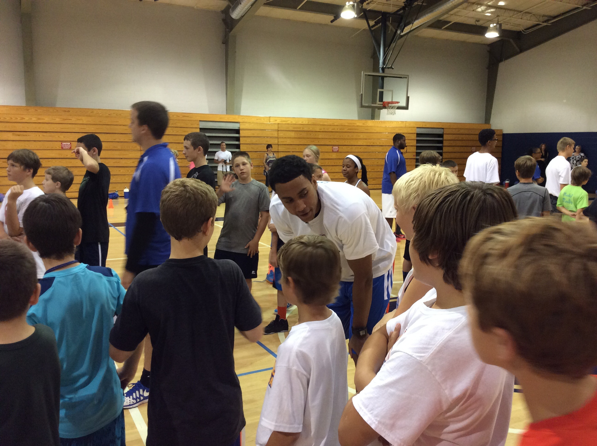 Thunder rookie small forward Josh Huestis talks to Thunder Youth Basketball campers at Casady School. Photo by Randy Renner for InsideThunder.com