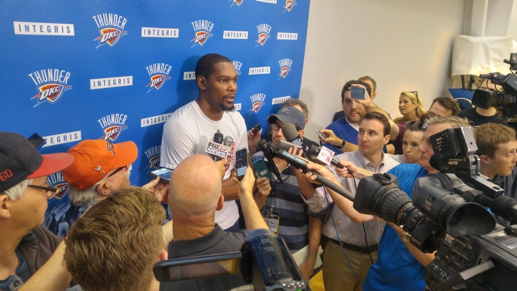 Thunder forward Kevin Durant is surrounded by reporters and cameras after a recent OKC practice session.