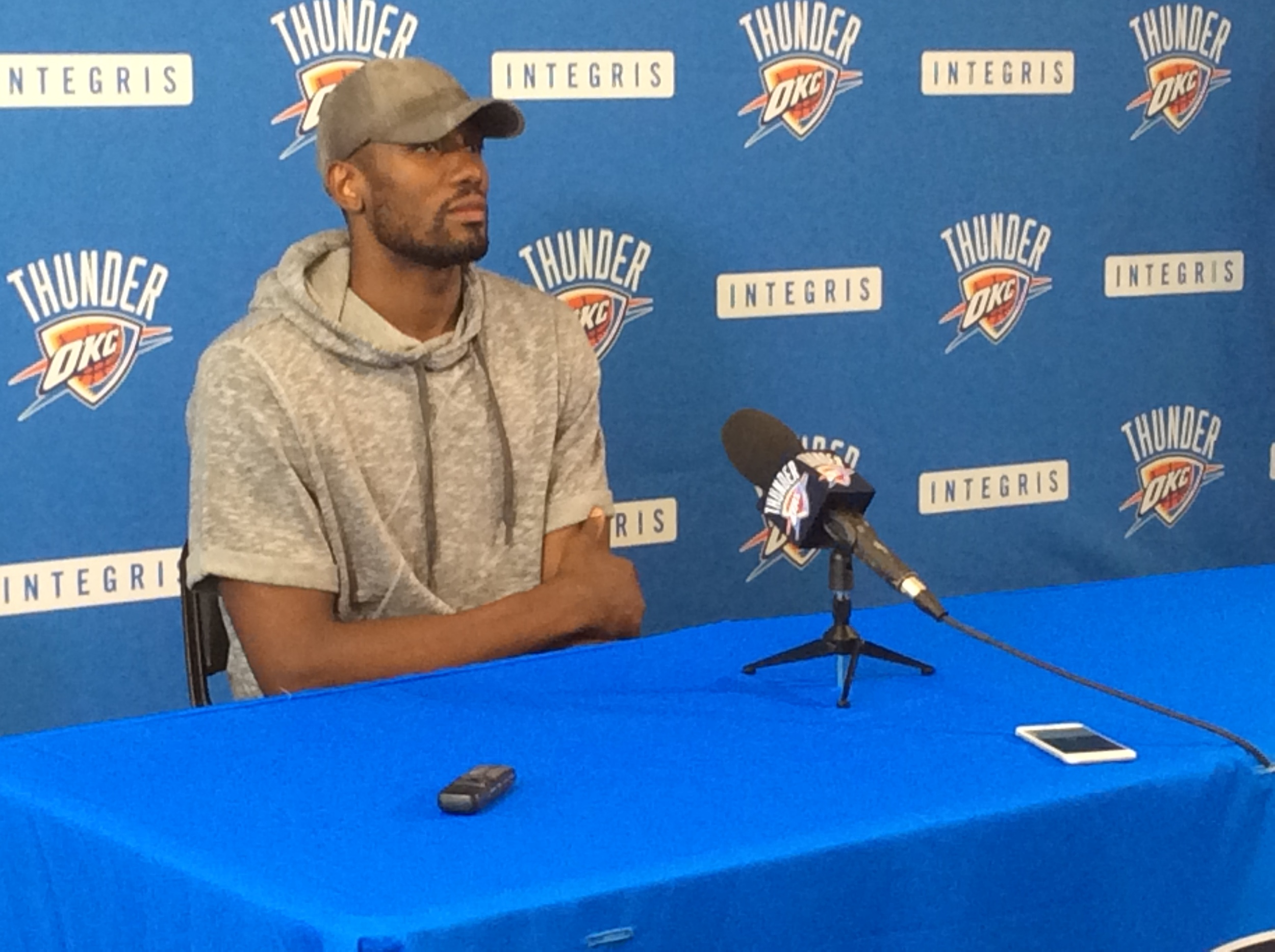 Serge Ibaka listening to a reporter's question during Thunder exit interviews earlier this month. (Photo By Randy Renner/InsideThunder.com)