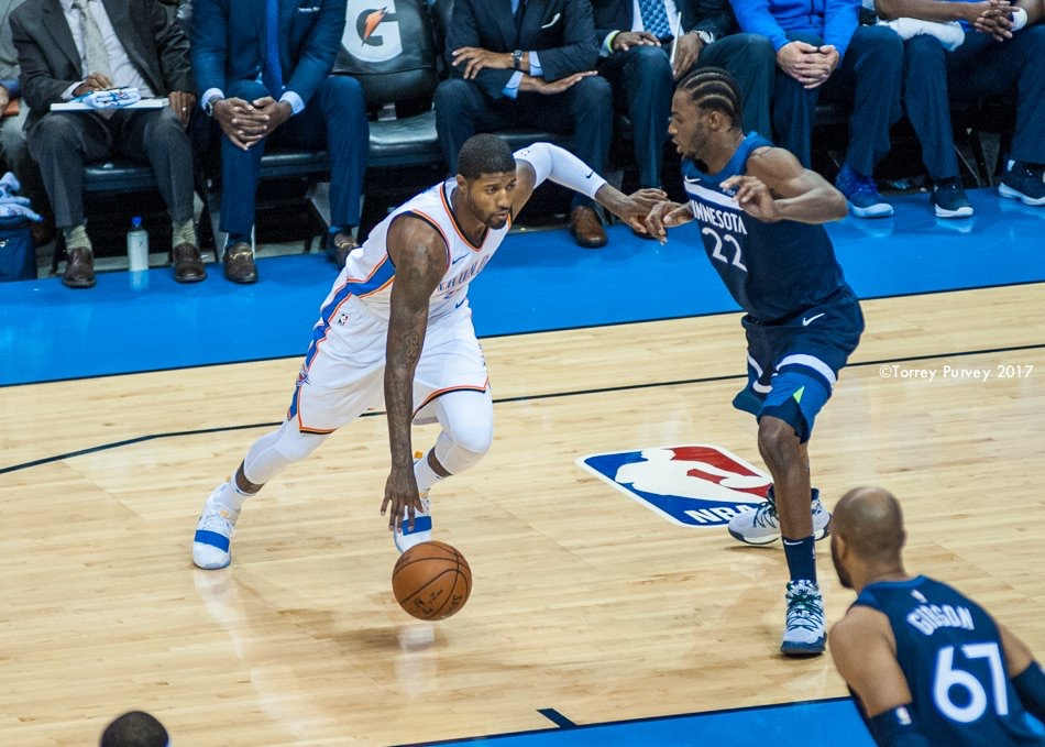Thunder small forward Paul George dribbles past Minnesota's Andrew Wiggins during OKC's 115-113 loss on Sunday night at Chesapeake Energy Arena. (Photo By: Torrey Purvey/InsideThunder.com)