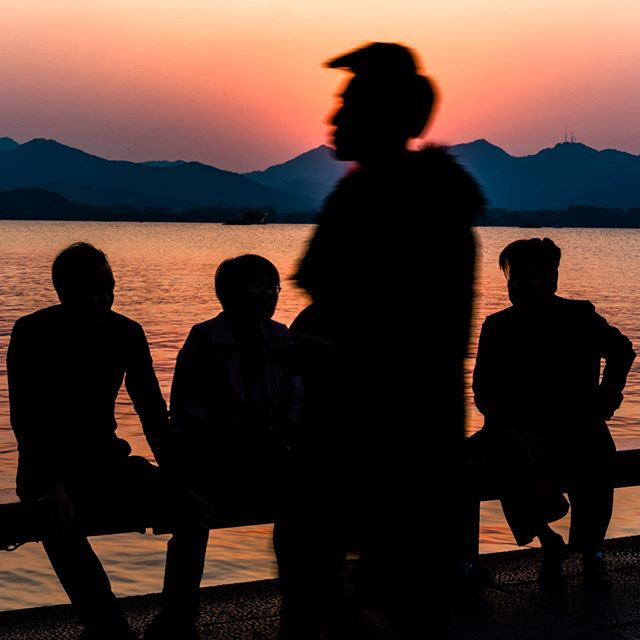 An out take from a recent assignment for NYT's Tbrand in Hangzhou, China. Silhouettes at the city's scenic West Lake at sunset. Check out the write up on the city here https://www.nytimes.com/paidpost/hangzhou-tourism-commission/ancient-city-with-electric-dreams.html. I found it to be a pretty nice place! #china #hangzhou #nyt #tbrand #advertorial #sunset #lake #westlake #silhouettes #tinypeopleinbigplaces  #bestplacestogo  #cityview  #travelphotographer #traveldeeper #letsgosomewhere  #moodygrams  #passionpassport #ourplanetdaily #sonya7riii #sonyalpha #sonyimage