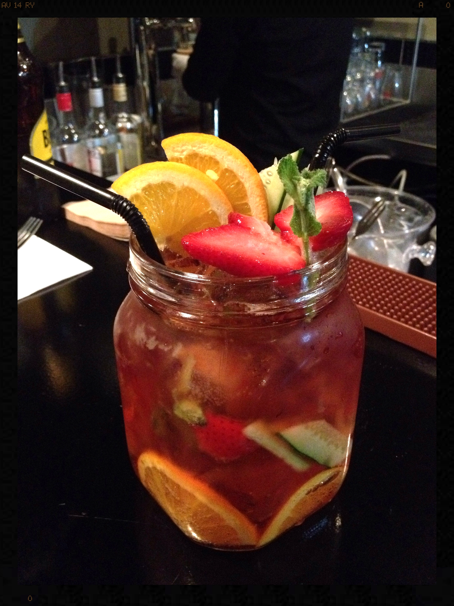 The Original Classic here. It is served in a huge Mason jar, and has 4 shots of Pimm's in it. I think this was 12 000W. Great and refreshing, made with tons of fresh fruit.  I think they are litre sized Mason jars!Both of these drinks need two hands to pick up! Totally worth it!