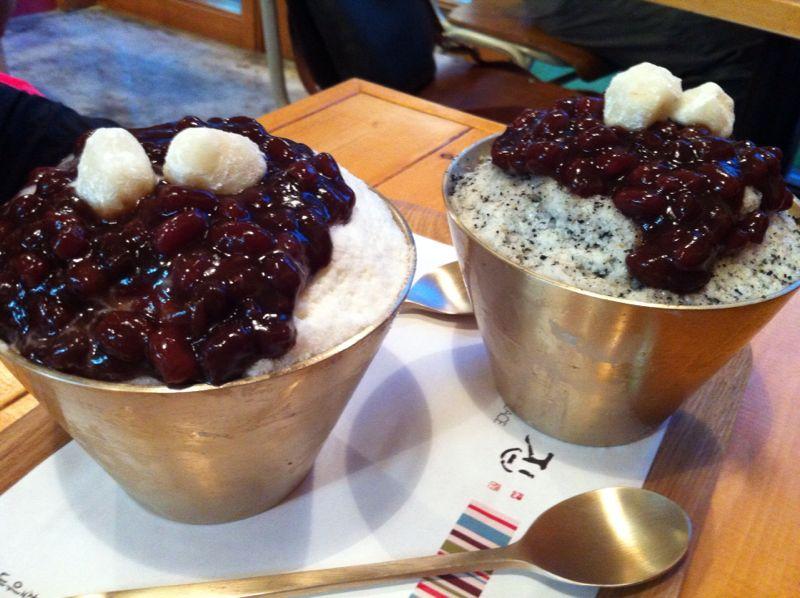흑임자빙수 (Black Sesame) and 단팥빙수 (Original Milk)  Many locoations around Seoul, but I usually go to the one at Noksapyung/Kyunglidan or Apgujung:https://www.facebook.com/sweetplace.sinsa