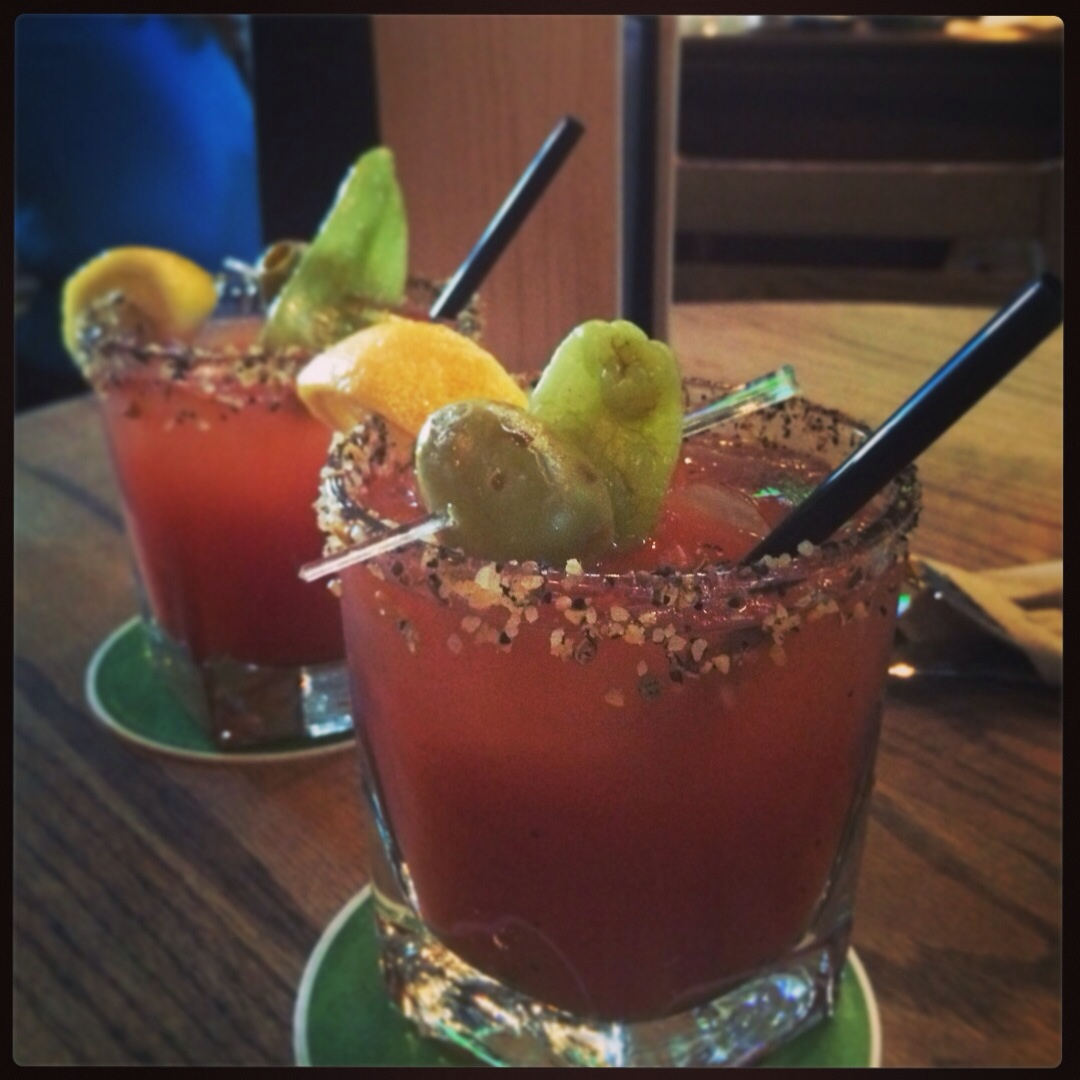 @Craft, Olympic Village, Vancouver, BC, Canada.  Classic caesar - comes with lemon, a olive and jalapeño garnish, chunky sea salt and pepper on the rim.