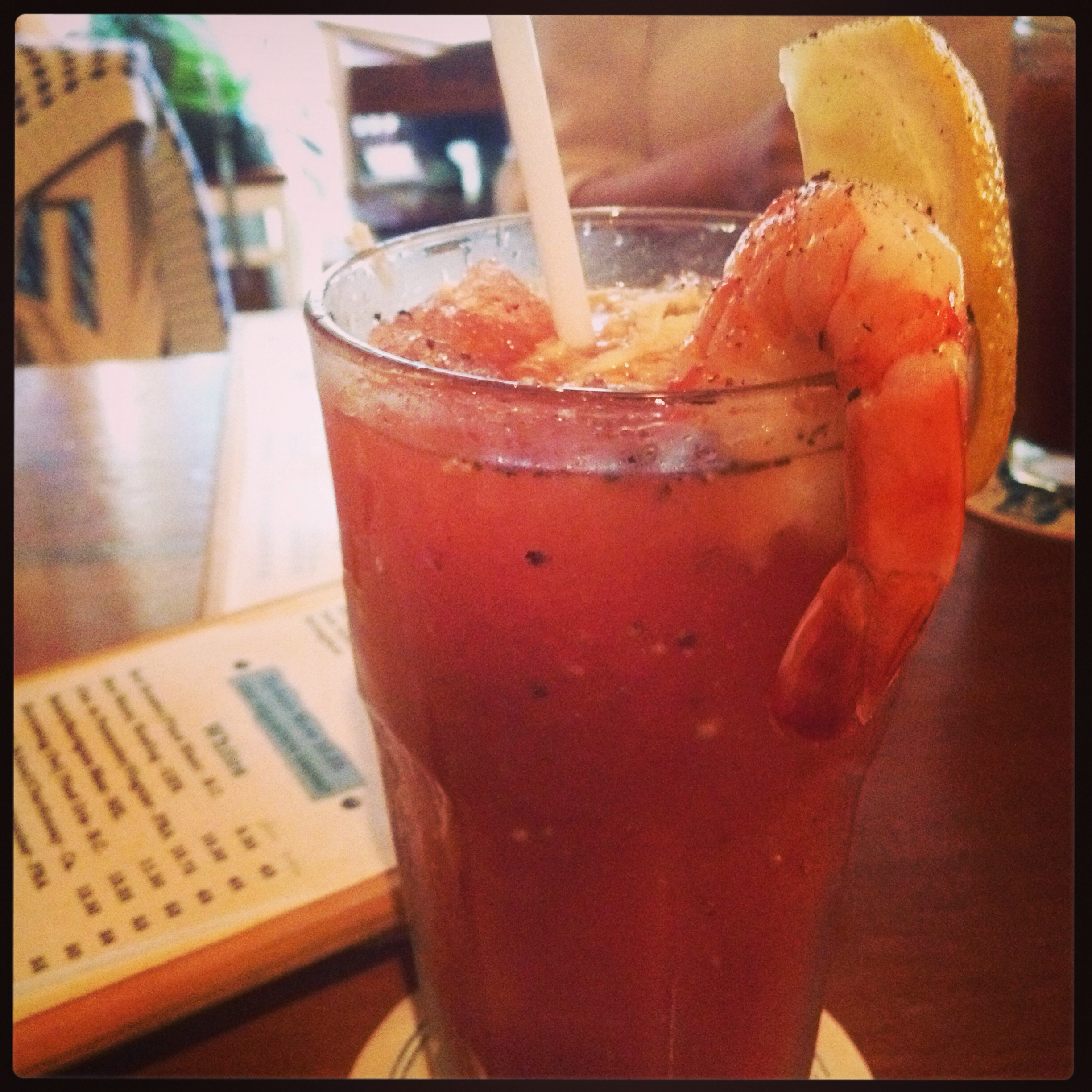 @Rodney's Oyster House, Gastown, Vancouver, BC, Canada.   Both very similar, crushed ice in a caesar with lemon, fresh horseradish and a prawn for garnish.