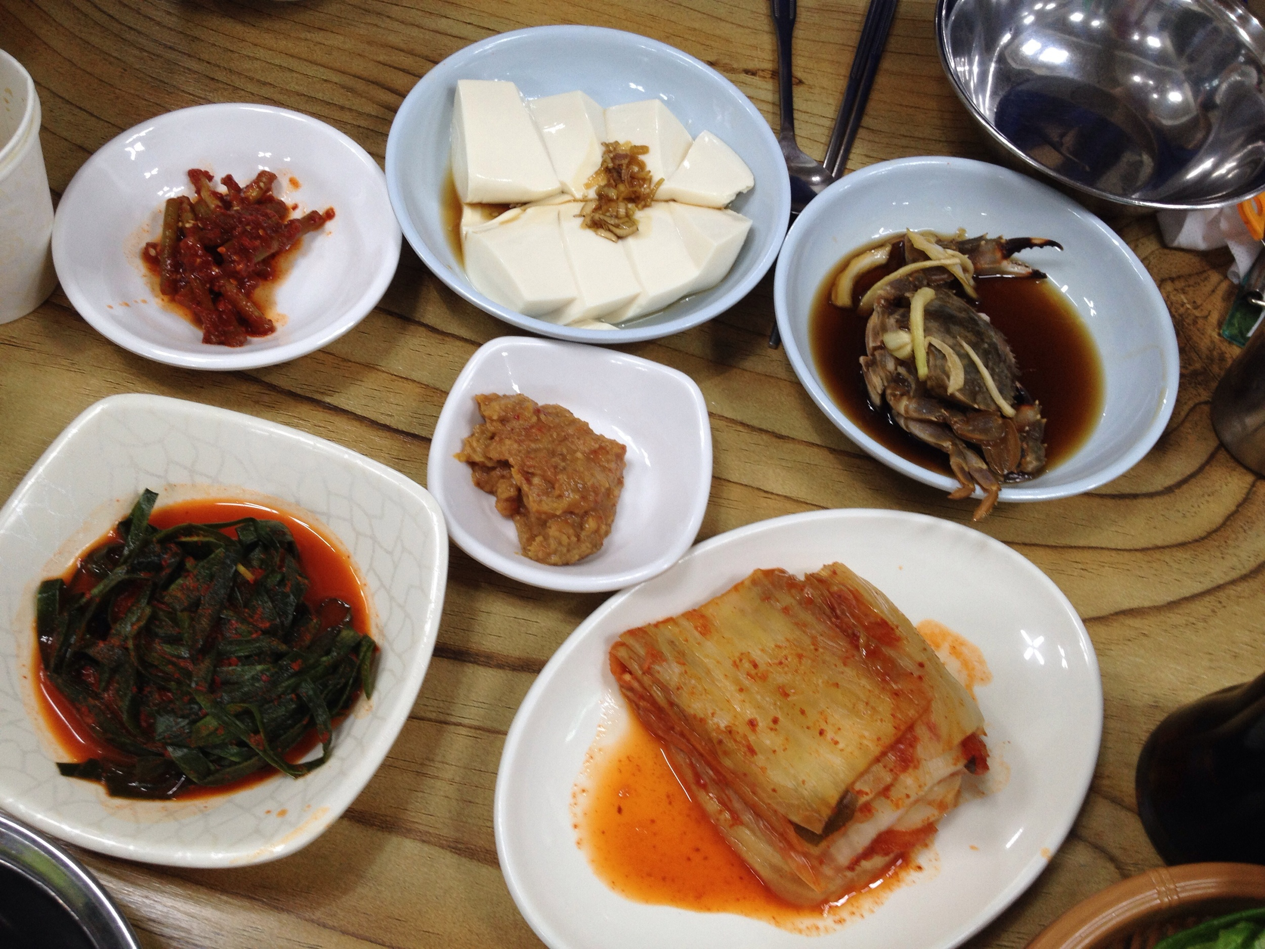 Simple selection of sides dishes. Awesome that they give 간장게장 (GanJangGaeJang) - raw soy sauce marinated crab.