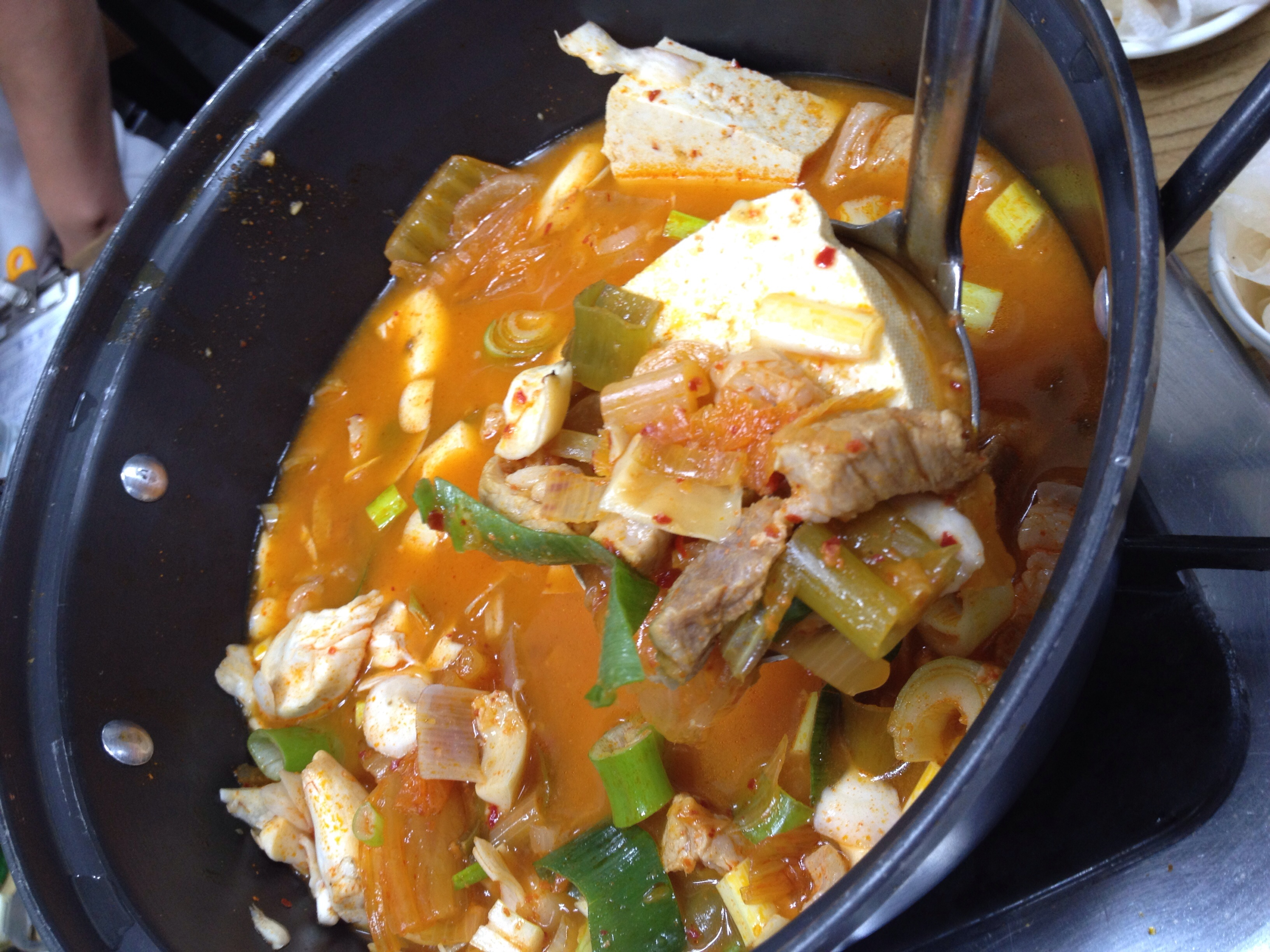 Reason #2 - Here, the stew is very generous with the ratio of meat to kimchi to soup! Kimchi jiggae is a classic Korean stew with a spicy soup base made with red chill pepper paste, kimchi, meat or tuna fish, tofu, onions and green onions. Delicious!