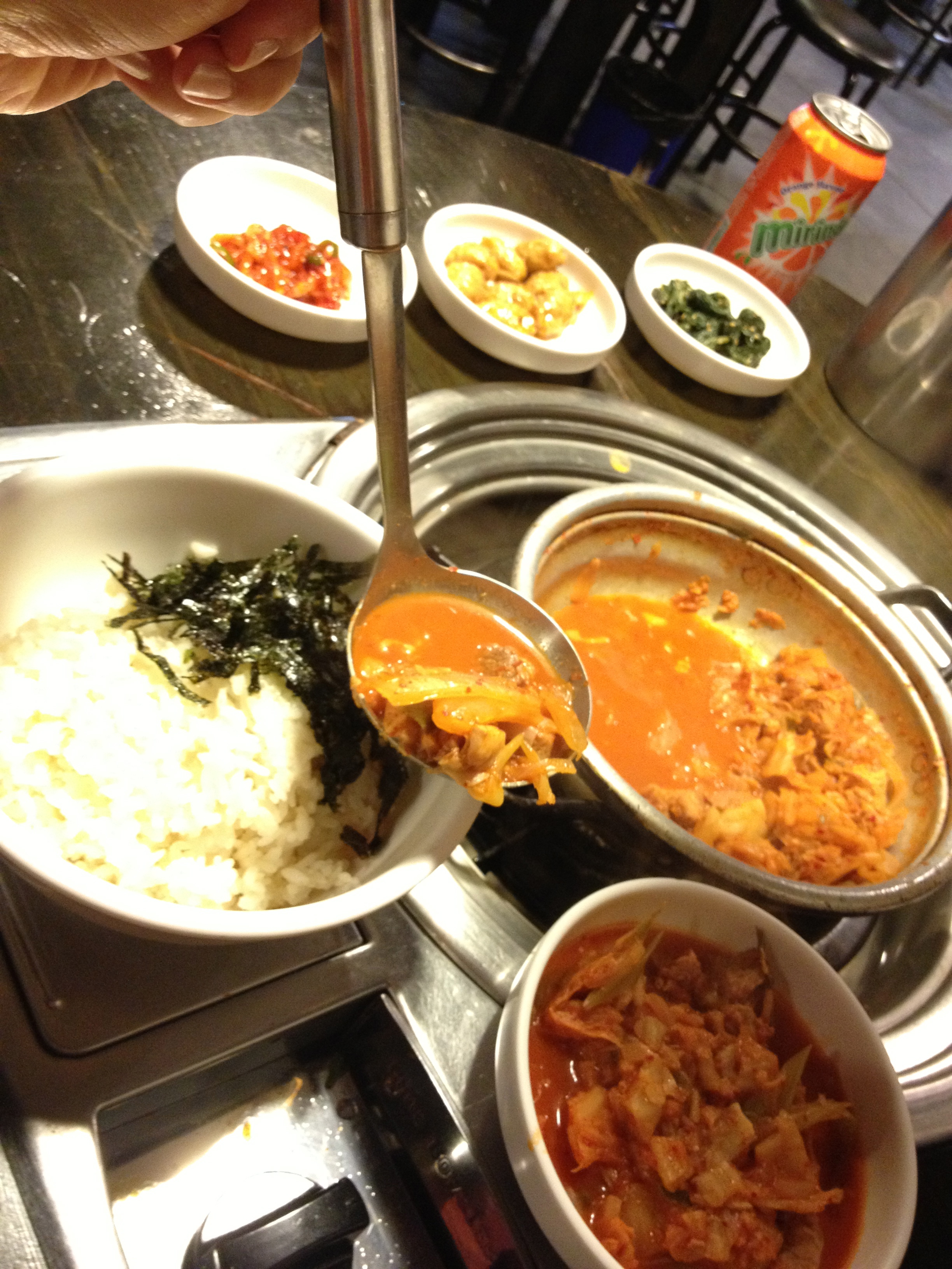 One of the dishes this place is known for:  7 minute kimchi jiggae (7 분돼지김치 찌개). A thick stew with chopped up kimchi and pork chuncks that is served boiling hot in just 7 minutes!