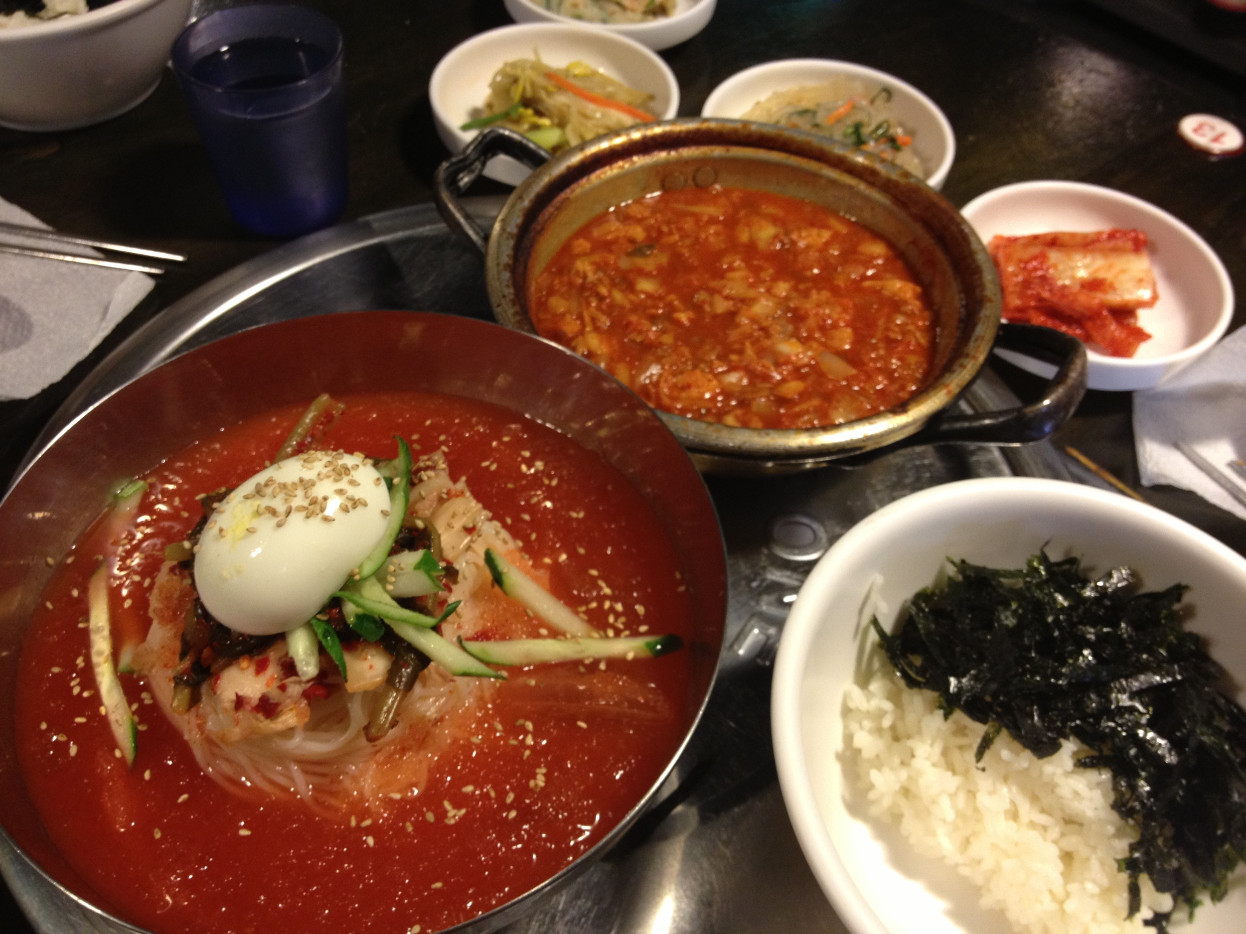 """Breakfast of champions: Had the hot kimchi jiggae and the cold kimchi noodles ( 김치말이국수) to have a nice """"balanced"""" meal of hot and cold dishes for breakfast one morning! Love that this place is 24 hours!"""