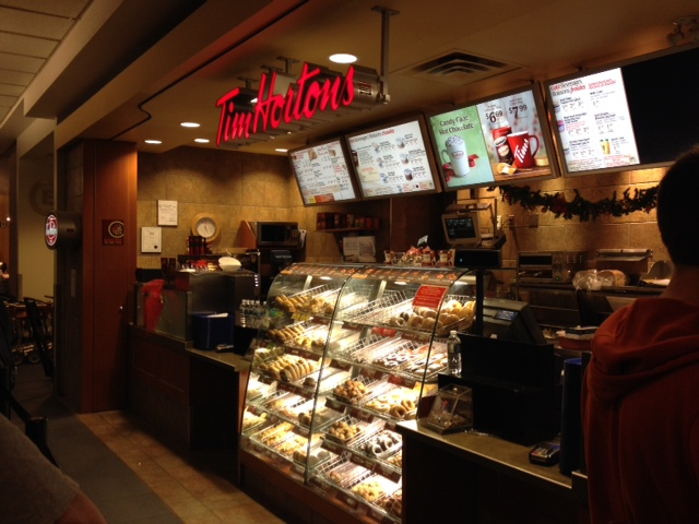 """The closest one after you land at Vancouver International Airport (YVR) is this one right here in the arrivals section! A warm welcome of coffee (famous for their """"double double"""" - which they even have a visa credit card for btw!), donuts, bagels, sandwiches, soups and chilli."""