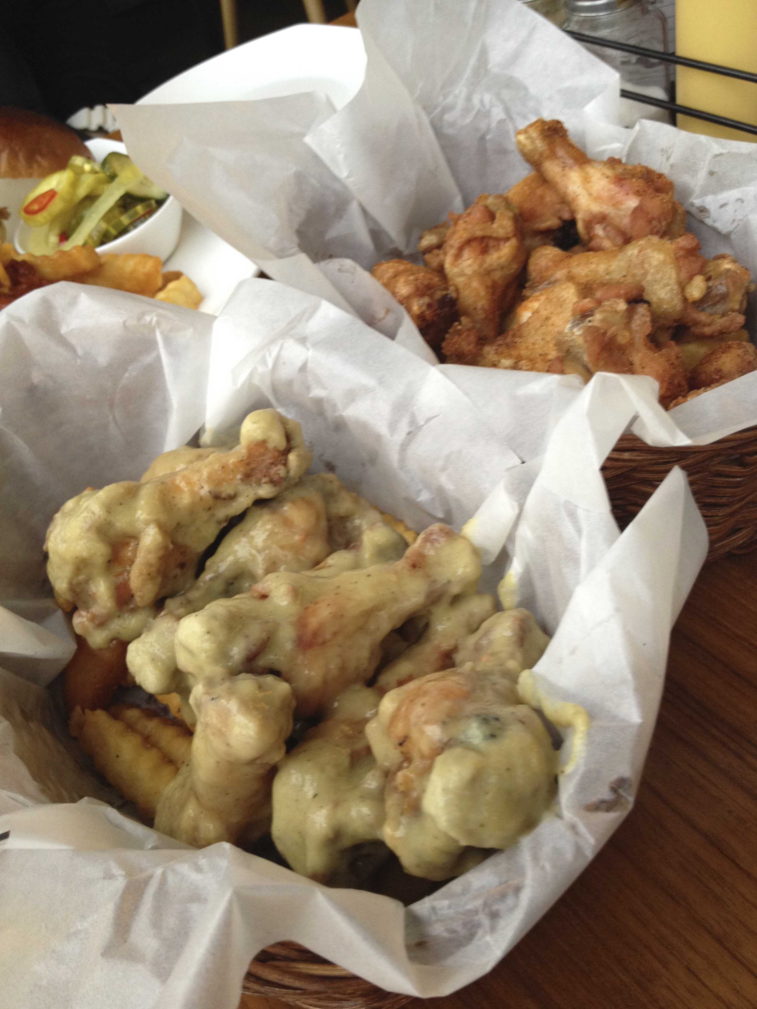 """Chili King - One Night in Bangkok. """"Crispy wings bathed in delicious green curry sauce""""."""