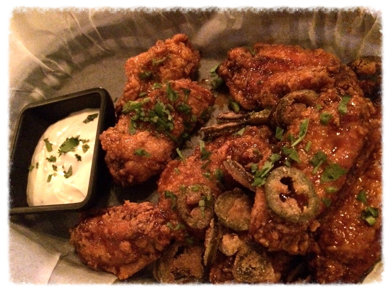 """Honey Tequila Chicken Wings - """"Original recipe with a Mexican flair! Wings coated in our sweet & spicy honey tequila sauce, served with deep-fried masa-battered jalapeños and blue cheese dipping sauce. 12 000won.""""  These wings are SO good. Apparently there is a proper Vatos way to enjoy these babies. Take a fresh hot wing, dip it in the creamy blue cheese dip and then top it off with a crispy juicy deep fried jalapeno and your bite is full of exploding flavours that just go oh-so-well together. Korean-mexican may not be the first place you think of for chicken wings, but these are the best!  You can even get them delivered, along with all their other great menu items, right to your doorstep with  Y-not delivery ! If they're not as hot when they get to you, just stick them in the toaster oven for a few minutes and they are just as good as dining in!"""
