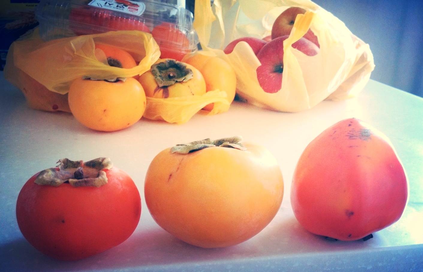 There are 3 main different kinds of persimmons. From left-right:  연시 (yun-shi),단감 (dan-gam),홍시 (hong-shi).    1 and 3 can be made into 곷감 (ggot-gam) which is simply a dried version of the fruit. These are delicious and chewy when dried, and can also be cut up and used as fillings for Korean cookies. 1 and 3 can also both be put in the freezer and enjoy as a frozen fruit treat. Once it thaws a bit, the frozen flesh tastes like a sweet sorbet - it's an all natural healthy option to ice-cream!