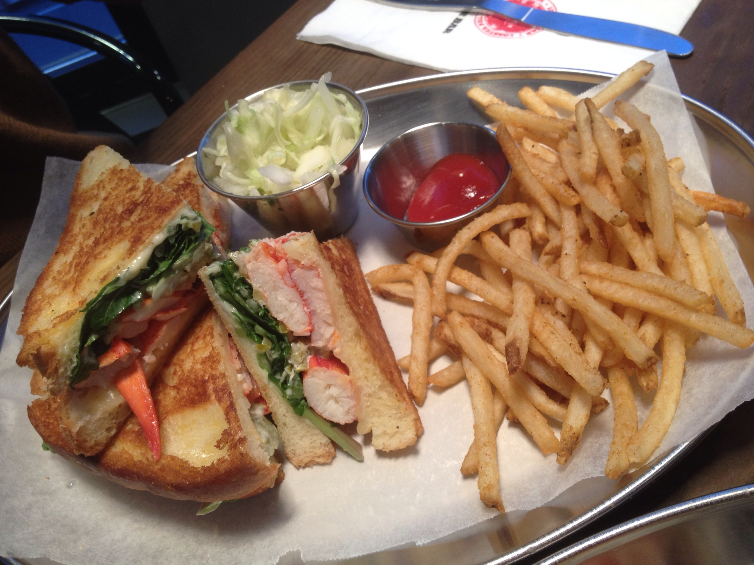 "Lobster Grilled Cheese - ""Lobster chunks, american and gouda cheese, arugula, lobster bar seasoning, served with fries and salad""  Delicious - make sure to eat this when it's served hot right away. The crunchiness of the toasted bread and arugula contrasts so nicely with the soft lobster meat and gooey cheese."