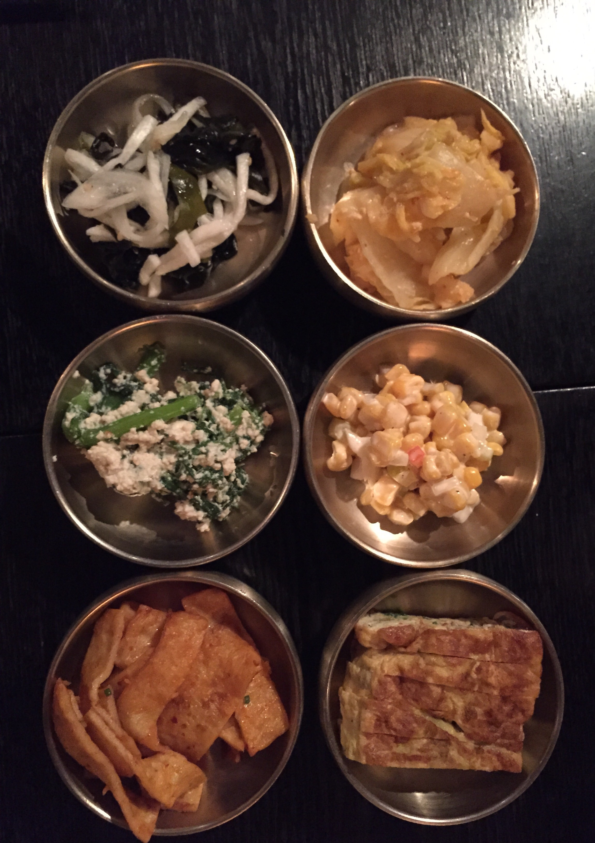 The 반찬 (banchan).  Free refillable side dishes that come with all meals. Nice selection of seaweed in vinegar, whie kimchi, crown daisy vegetable in soft tofu, corn in mayo, fish cakes andegg omelette.