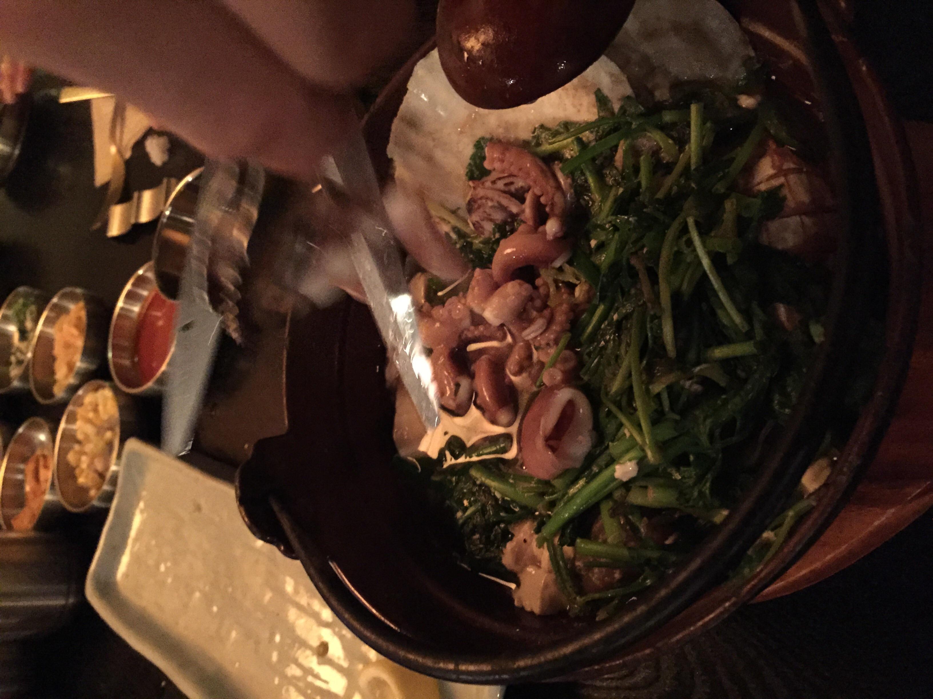 해물 백 순두부 탕 (HehMool Bek SoonDooBoo Tang) -  Seafood in a w  hite broth tofu soup. 40 000won  There is a ton of various seafood in this soup - scallop, clams, abalone, langoustine along with vegetables and octopus.