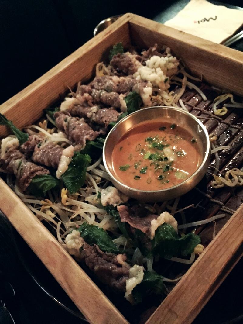 한우차돌찜 (Hanwoo Chadol Jjim) - Steamed Korean beef wraps. 35 000won.    The chadol is wrapped around a sesame seed leaf and then steamed upon a bed of bean sprouts.