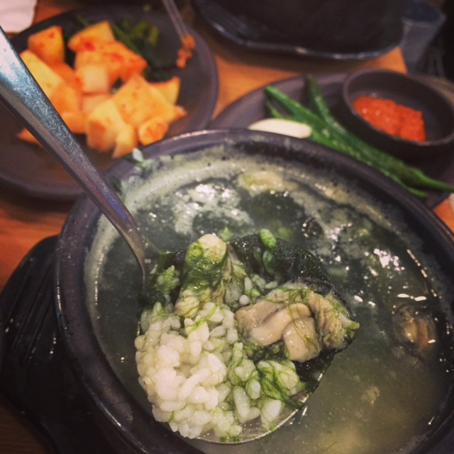 매생이굴국밥 (Maesaengji Gool Gookbap). 8000won  Slimy, goopy seaweed with oysters and rice in a savoury soup that comes out bubbling and boiling over the top of the bowl.