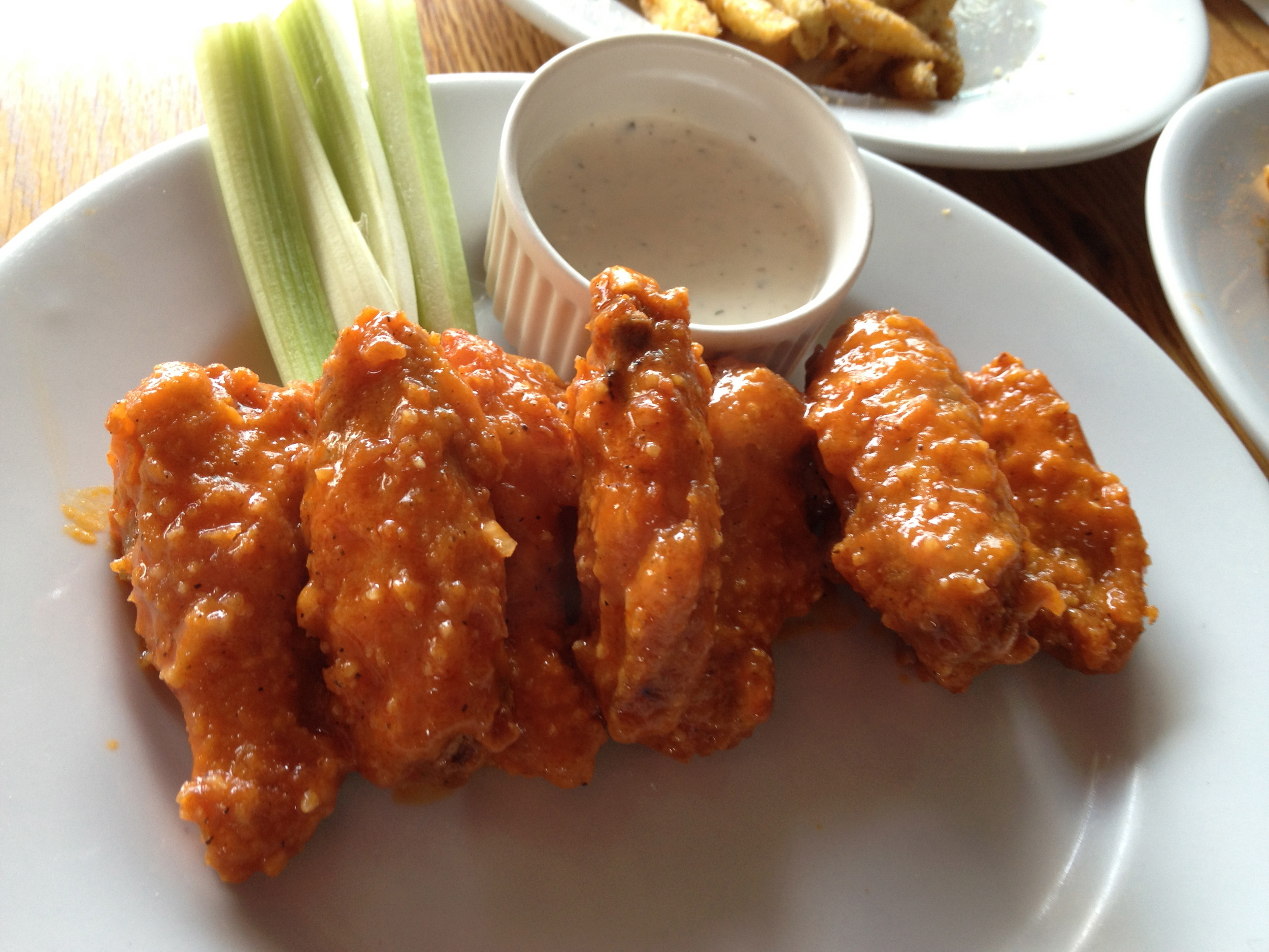 "Buffalo Hot Wings: ""BONY's homemade hot wings, served with ranch sauce."" 9000won  I was a bit disappointed with these wings. They were TINY! I hear that wing sizes in Korea depend on the shipment, but there were too small, and the sauce was too vinegary and spicy without for a buffalo wing. I love buffalo wings but I will stick to the fries and pizza at this place.   I did a wing comparison blog in search of the best wings in Seoul. Check out my edition of  Best Chicken Wings in Seoul HERE!"