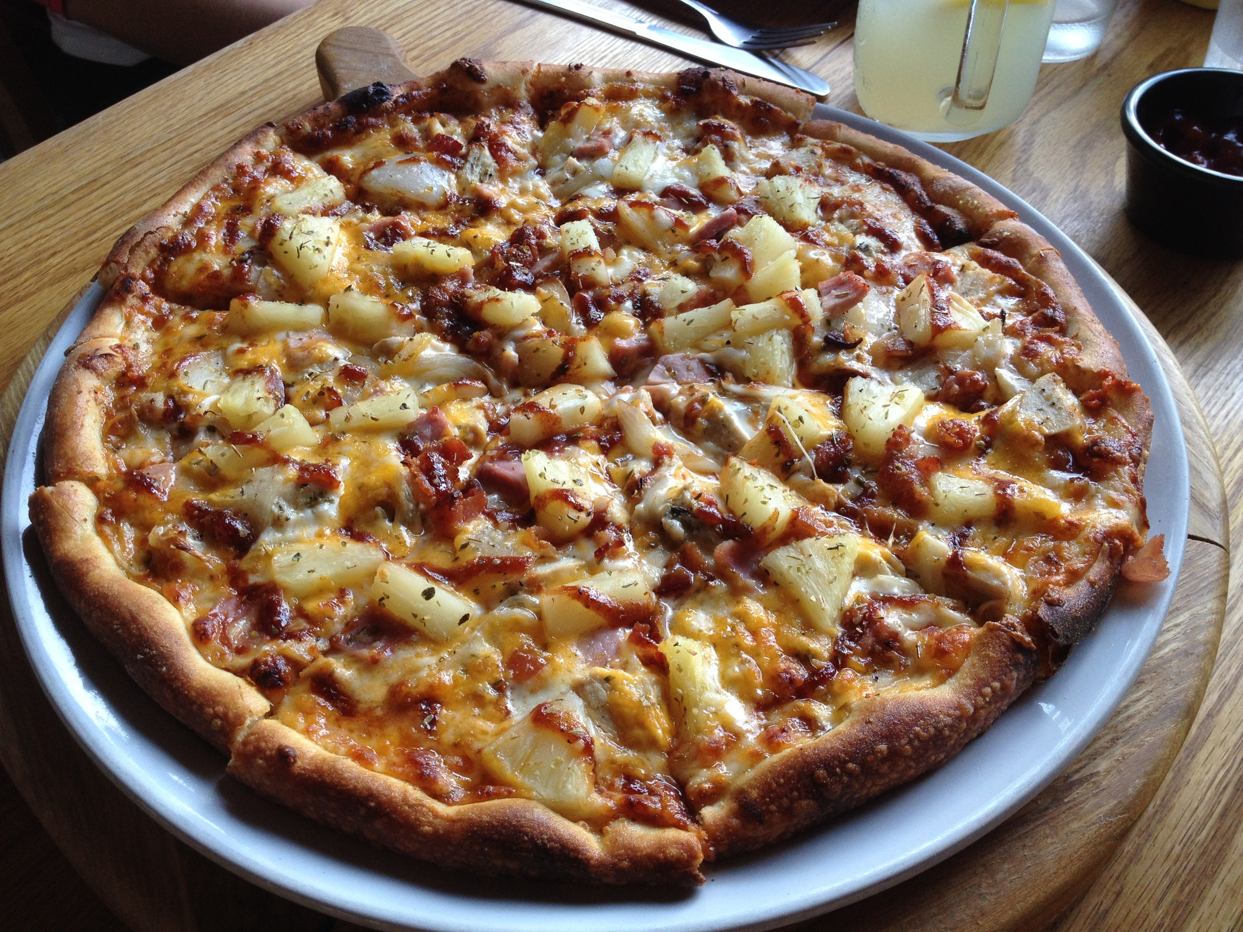 "Hawaiian BBQ: ""Grilled chicken, ham, bacon, onions, cheddar, pineapples, mozzarella, BBQ sauce.""  Couple size (2-3):   30 00won, Party (4-5):   45 000won.    I love Hawaiian pizza but I don't love BBQ sauce. This was still good, but I prefer original Hawaiian with ham and pineapples."