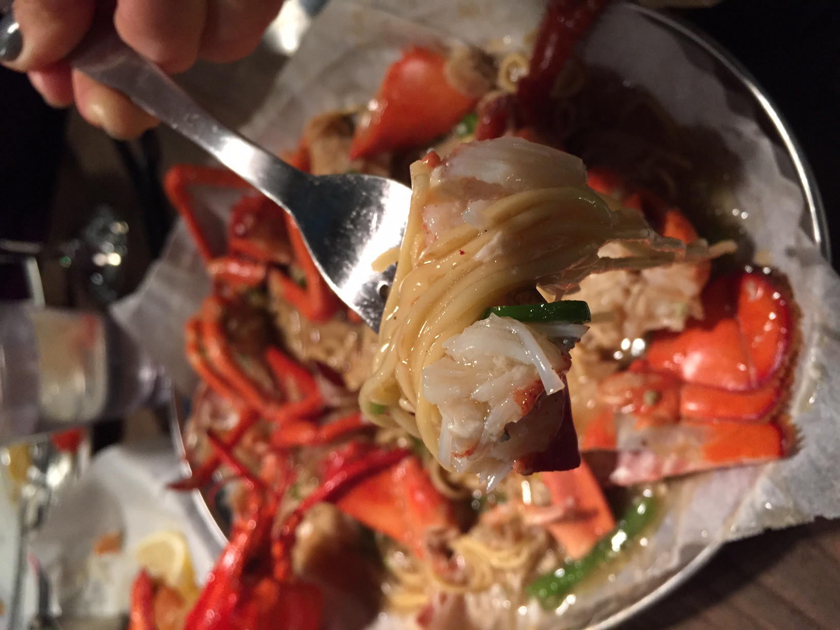Make sure you swirl up noodles, a piece of veggie and a nice chunk of lobster with each bite!