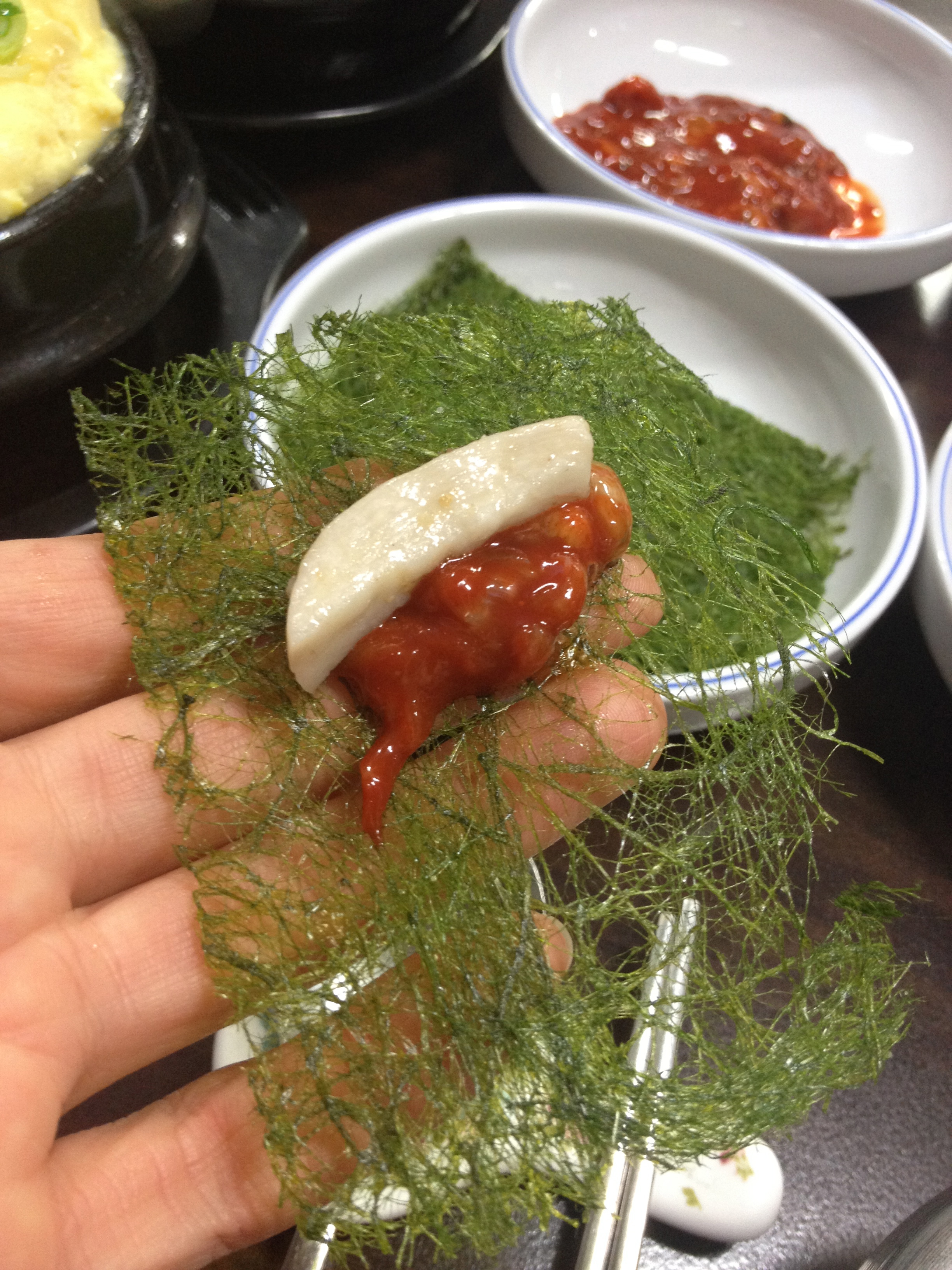 The seaweed is extremely delicate, airy and melts in your mouth. It almost has the consistency of Korean hanji paper, but melts in your mouth like cotton candy! You can put the other delicious side dishes like mushrooms and raw oysters in a spicy sauce on and enjoy the different textures and flavours together.