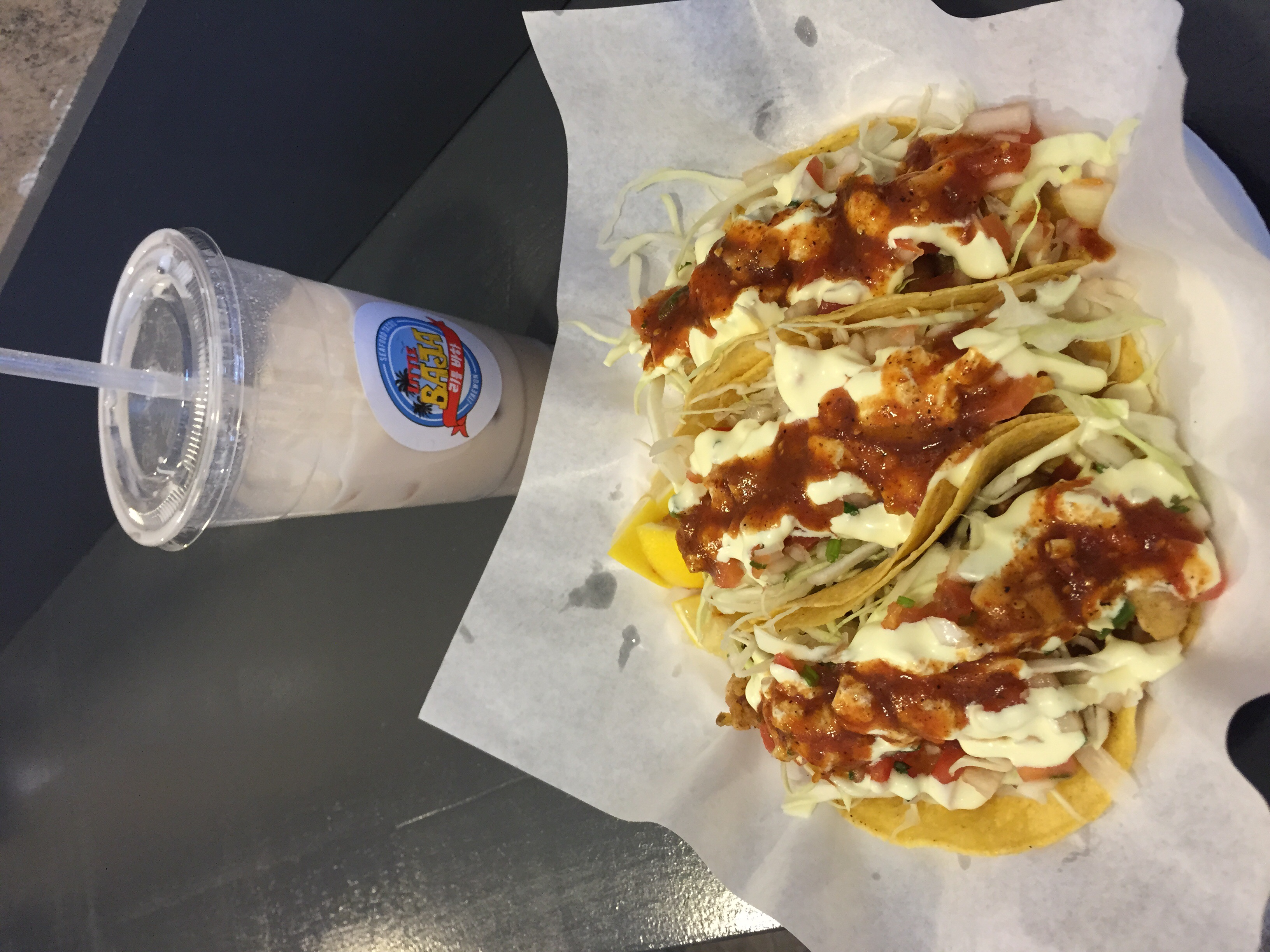 A taste test of all their seafood tacos on thinly pressed corn tortillas. All of their taco's are battered seafood, fried and topped with thinly cut cabbage, Baja style mayo and red salsa. I would order just the fish and octopus one next time again!