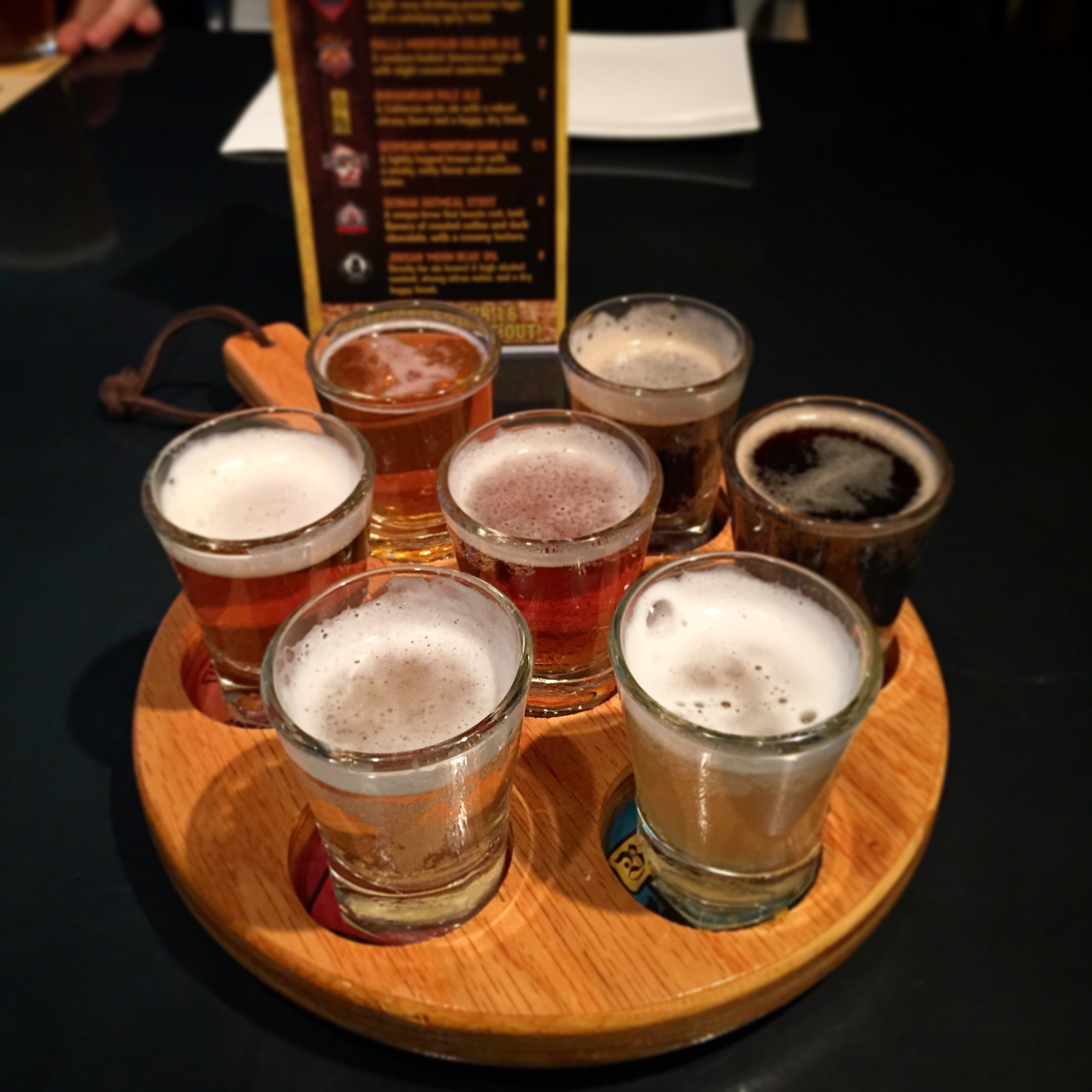 """Get the """"Sample Paddle"""" - 12 000won, which includes all 7 of the local draft beers to taste. Baekdusan Hefeweizen, Jirsan Moon Bear IPA, Bukhansan Pale Ale, Geumgangsan Mountain Dark Ale, Namsan Pure Pilsner, Halla Mountain Golden Ale andSeorak Mountain Stout.  My favourite is the Hallla Mountain Golden Ale - it tastes sort of like a Honey Lager. It's creamy withslight caramel tones. The sampler is a great option if you're not sure what kind of beer you like and want to taste them all. If you know your beer preferences already, ask for a suggestion from the server as they will be able to direct you to a great light, dark or bitter beer choice!"""