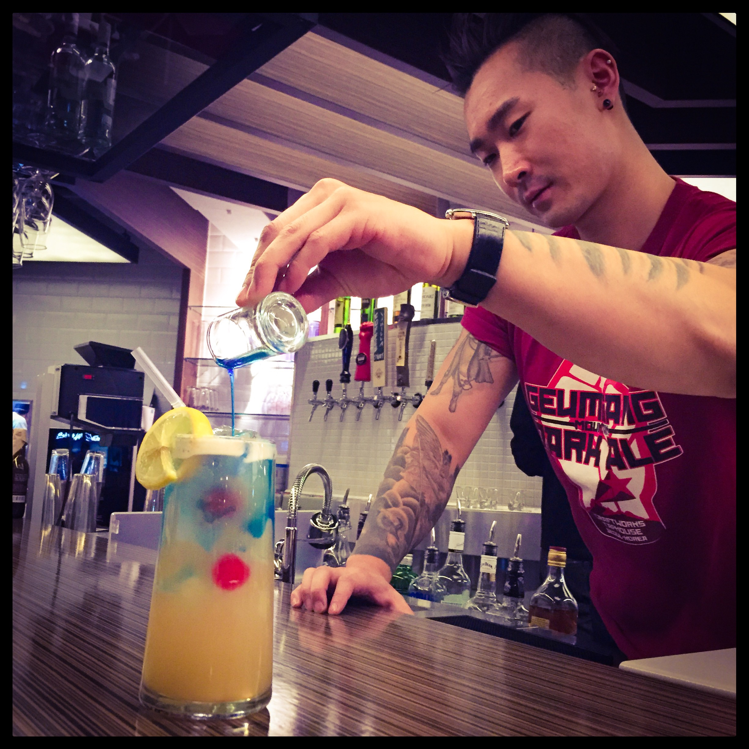 If beers don't tickle your fancy, Fredik is your man! He can make one of the SIGNATURE COCKTAILS that are on the menu for you, or even whip up a custom made one for you! This one pictured is an off-menu drink, but if you ask for a BLUE TATOO (we named it inspired by Fredik's tatoos!). It is very sweet, sour and has a nice punch to it if you are looking for a refreshing tropical kind of drink!