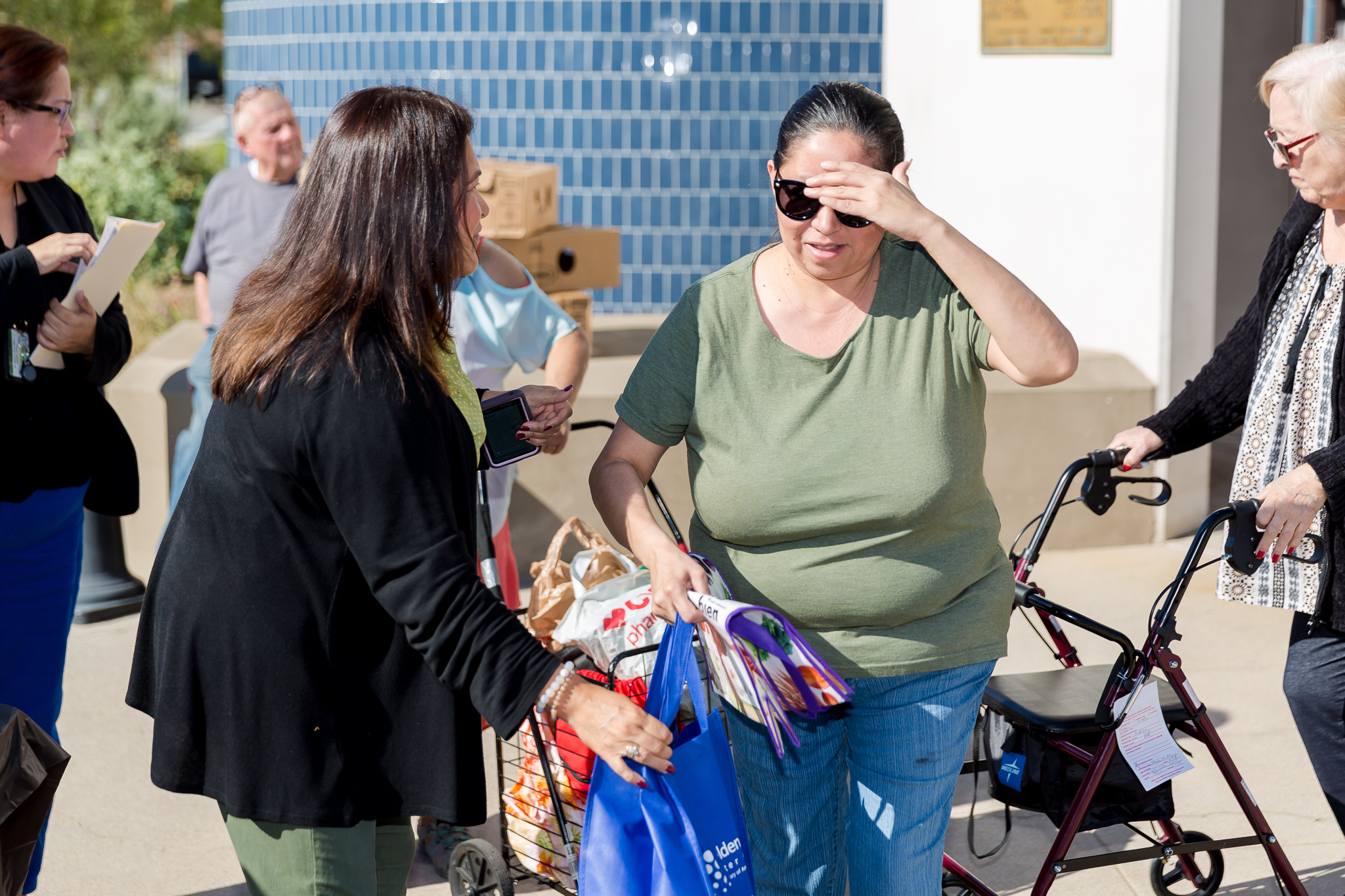 Council Member Angie English distributing turkey