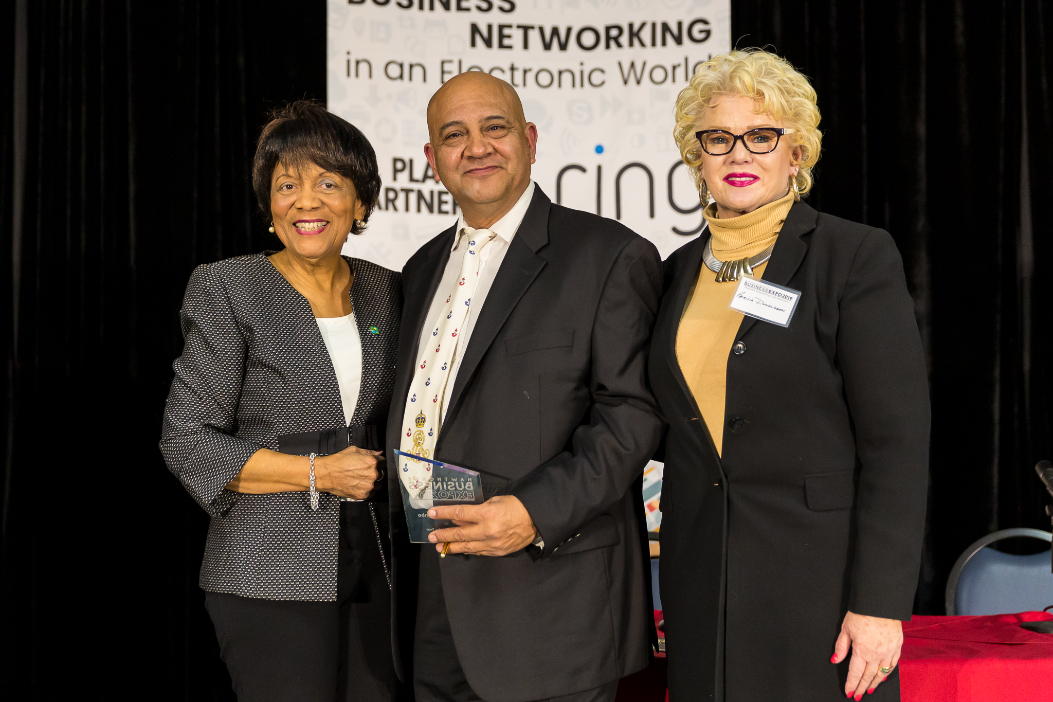 Olivia Valentine and Pat Donaldson with Business award  recipient