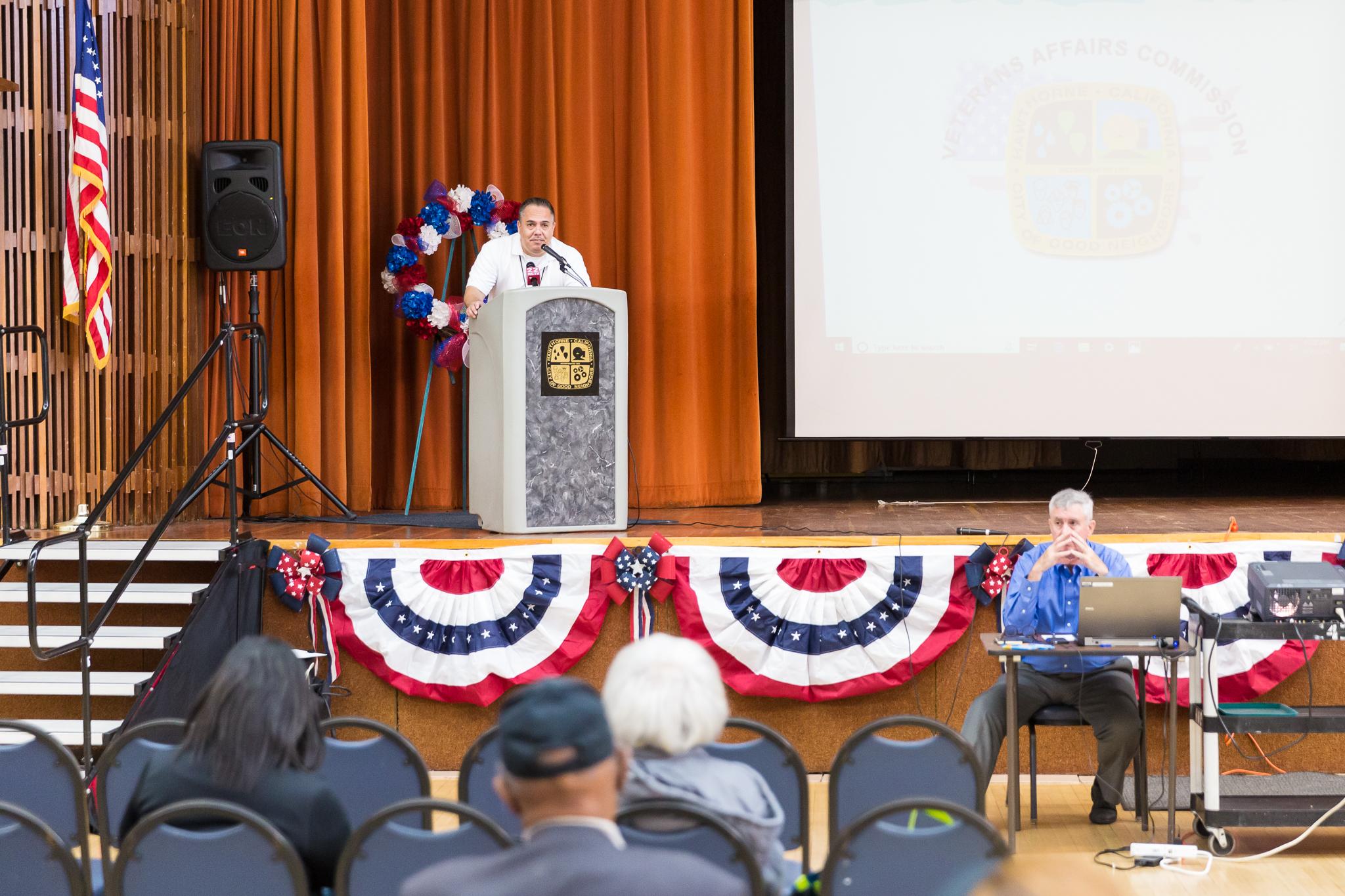 Mayor Alex Vargas at the podium