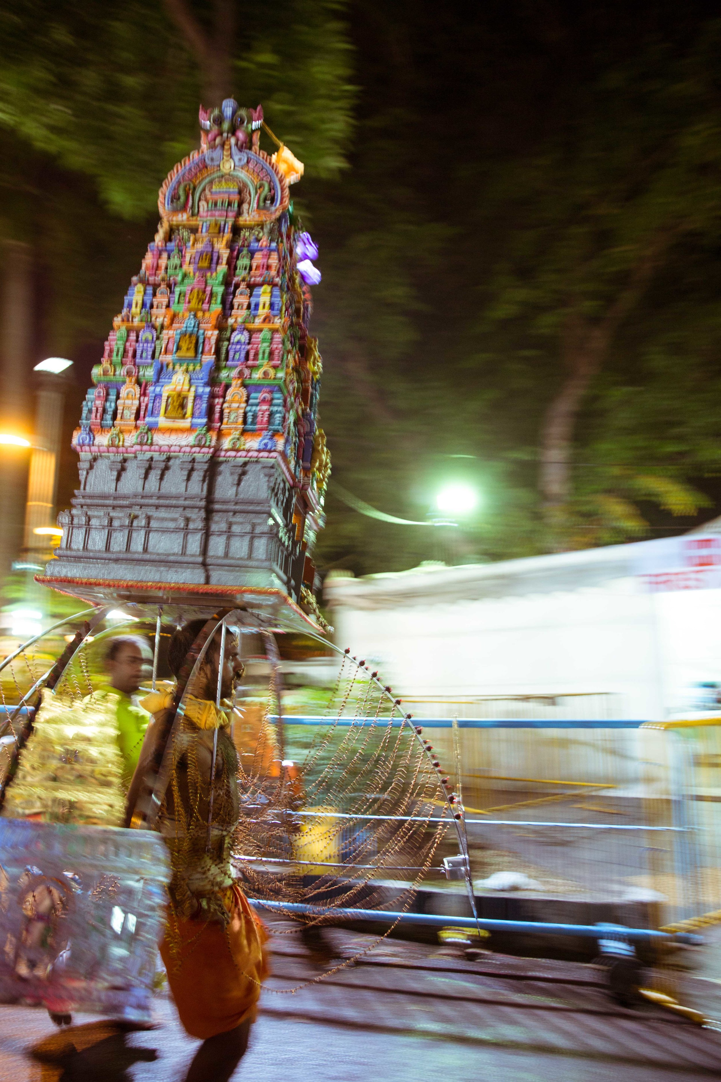 A devotee walking towards the Kavadi dismantling area.