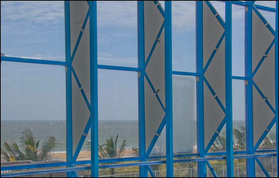 Window detail and view of beach from Princess Royale swimming pool
