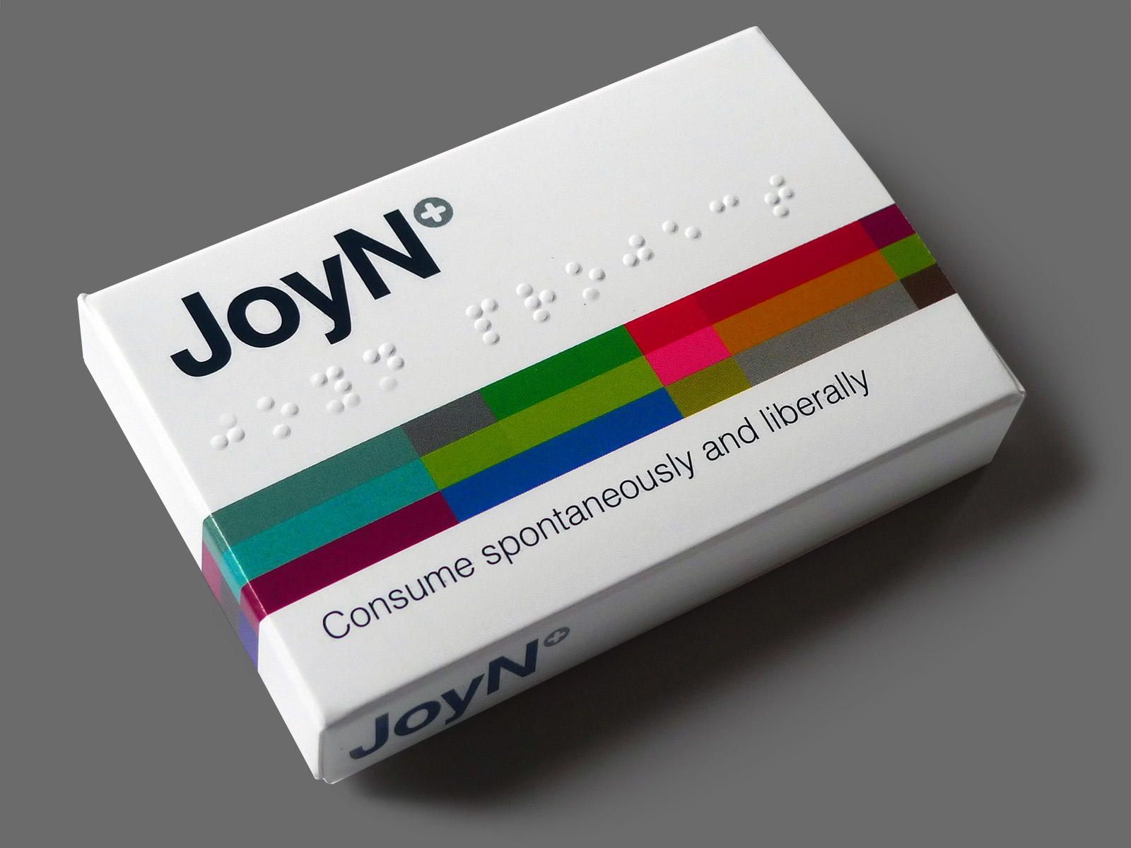 JoyN+  October 2016  JoyN+ was conceived by Joe Magee and subsequently funded by Barnwood Trust as a pilot project at a GPs' surgery in Gloucestershire. Working closely with Dursley GP Dr Simon Opher OBE and staff at his surgery, the aim is to help effectively implement 'social prescribing'.  Social prescribing is a way of linking people to groups and activities where they live that they might benefit from. Instead of prescribing medication doctors are prescribing connections to things such as art groups, gardening clubs and book groups. Research has shown that this approach is beneficial to people's physical and mental wellbeing.  JoyN+ takes the form of a pill packet that can be given to patients by the GP, or taken from the countertop box. Inside are business cards with information about individual local groups.The cards provide both ideas and contact details.  The JoyN+ concept sprung from an arts and health discussion group instigated by Create Gloucestershire.  LINKS  Barnwood Trust   Create Gloucestershire   JoyN+ © Joe Magee 2016