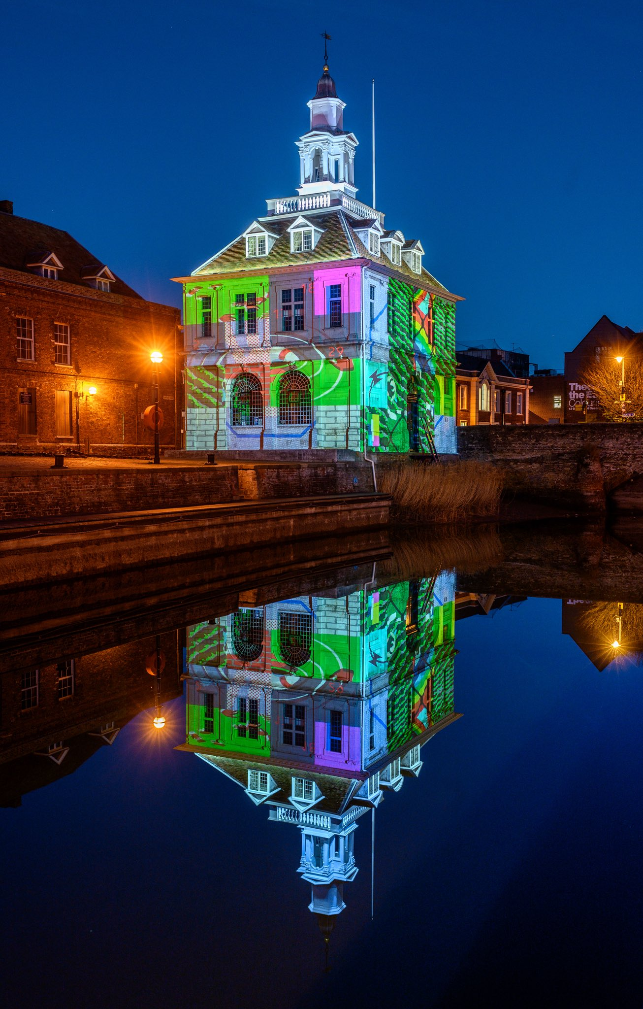 The Custom House  by Joe Magee, December 2018  The Custom House is an artwork by Joe Magee. It was commissioned by Cambridge-based arts organisation  Collusion  to form part of their  Reveal  project - a series of artworks and performances in Kings Lynn (England).  The large scale projection onto the 17th Century harbourside building sees fragmented images randomly altering. Visitors can interact using their smart phones to change and resolve the images so that the building becomes like a giant Rubik's Cube.  Joe's images explore the themes of Reveal - soul searching about migration, borders and brexit in the English heartlands. The interactivity and coding for the artwork was developed by cutting edge digital programmer  Pi & Mash .  Digital coding: Pete Cleary @ Pi & Mash. Produced by Marcus Romer and Simon Poulter. Executive Producers: Simon Poulter, Rachel Drury. Creative technologist: Richard Hall. REVEAL has been developed by the Borough Council of West Norfolk and King's Lynn working with Collusion. Additionally, the project has been funded by Arts Council England, Norfolk County Council, Discover King's Lynn and The Business Board. PHOTO CREDIT: Matthew Usher