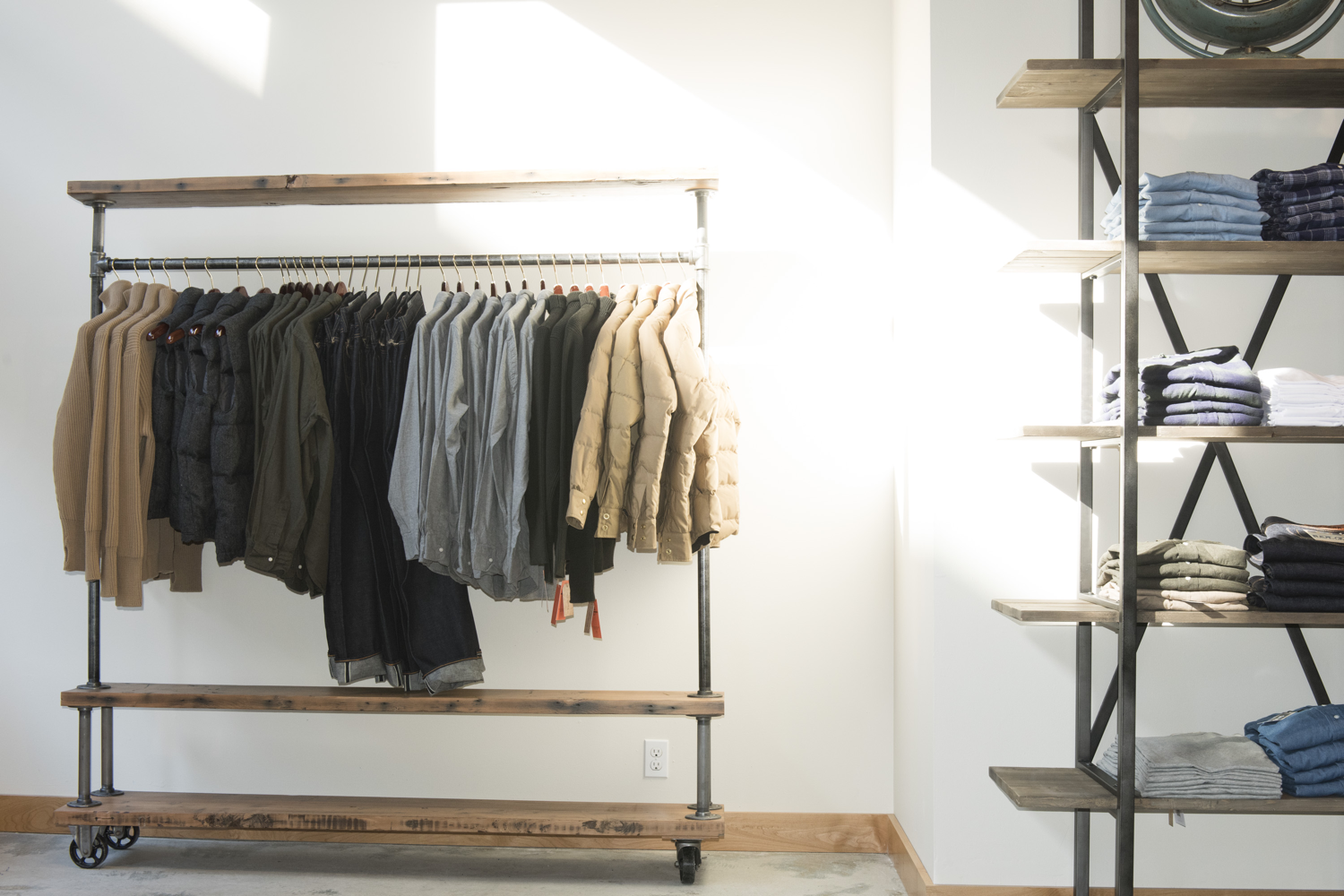 A rack of Oxfords, vests and denim at Division Road's store on 1st Ave South in Seattle.