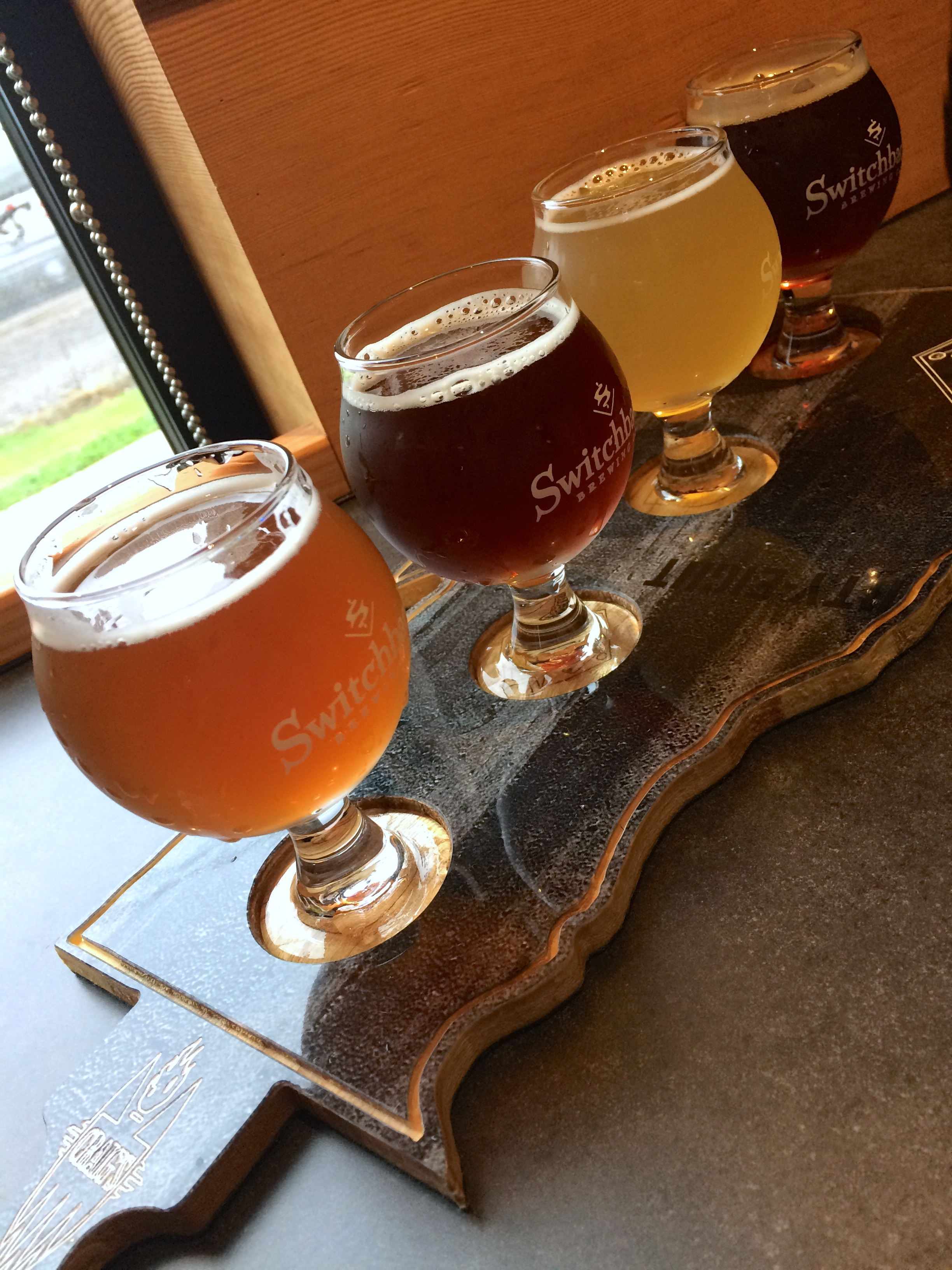 Visiting the new tasting room at Switchback Brewery. We were told to sample from the bottom of the state to the top: the classic Switchback Unfiltered Ale, a new Brown Ale, a new Citra Pils, and a Roasted Red Ale. The classic will always be my favorite.