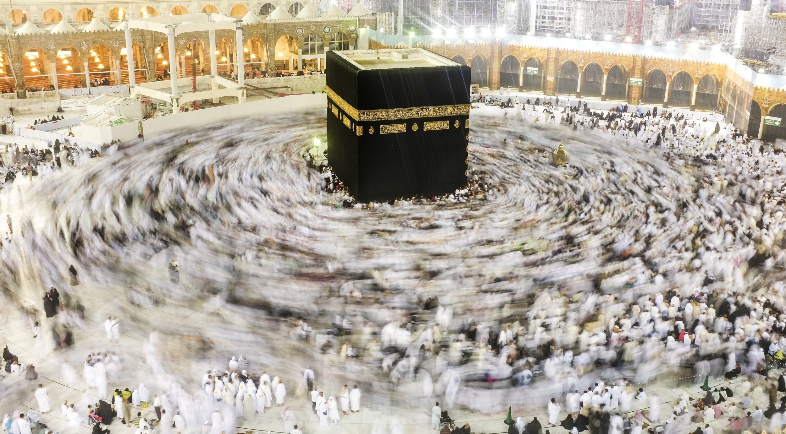 """Culture Study for #BrandUSA #MeltingPot. Walking a track or other kind of loop in walk-a-thon unity.  Links to Conde Nast Traveler's """"Beauty and Business of the Hajj"""""""