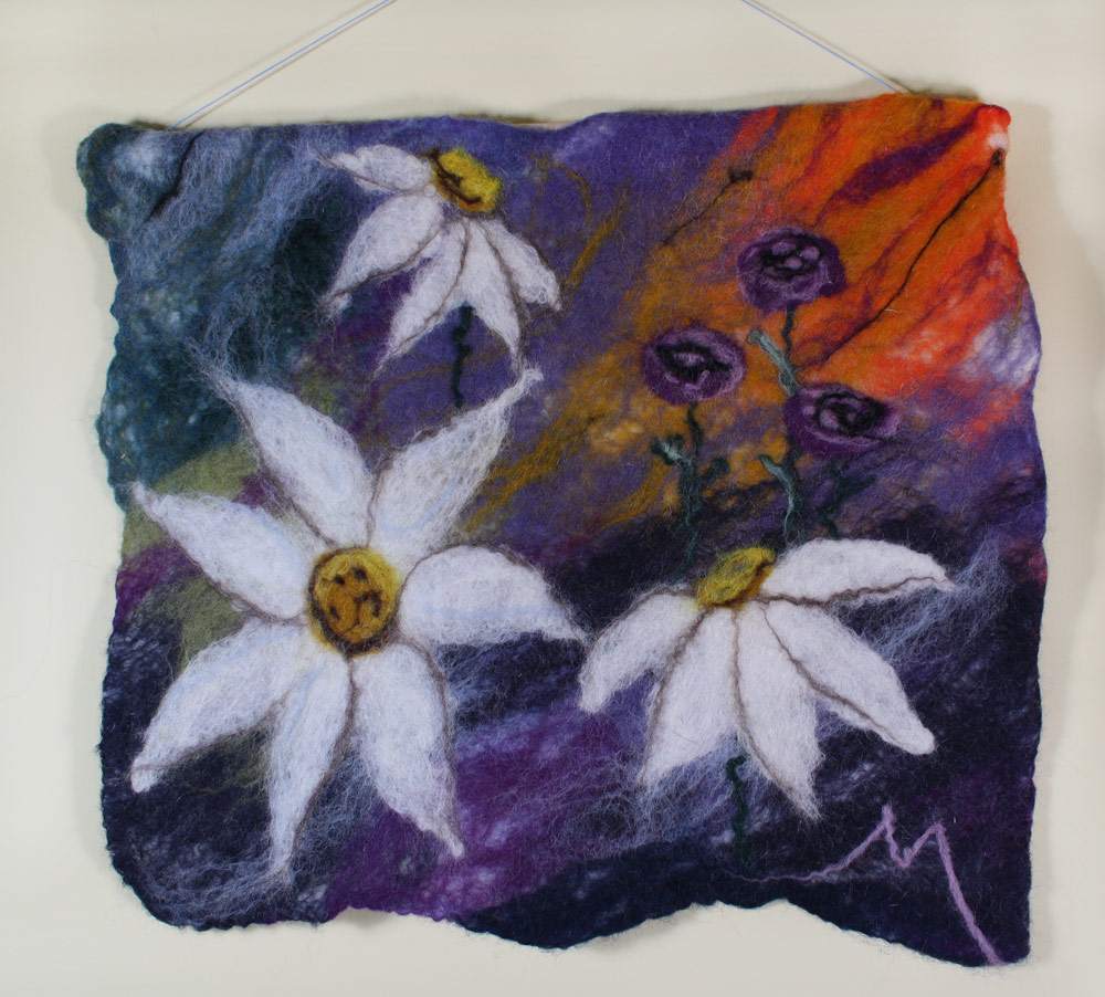 "Sunshine Storm Tapestry   Wet felted tapestry of flowers with dramatic background. 14"" x 16"" w 2 tabs on back for hanging on rod.  NFS"