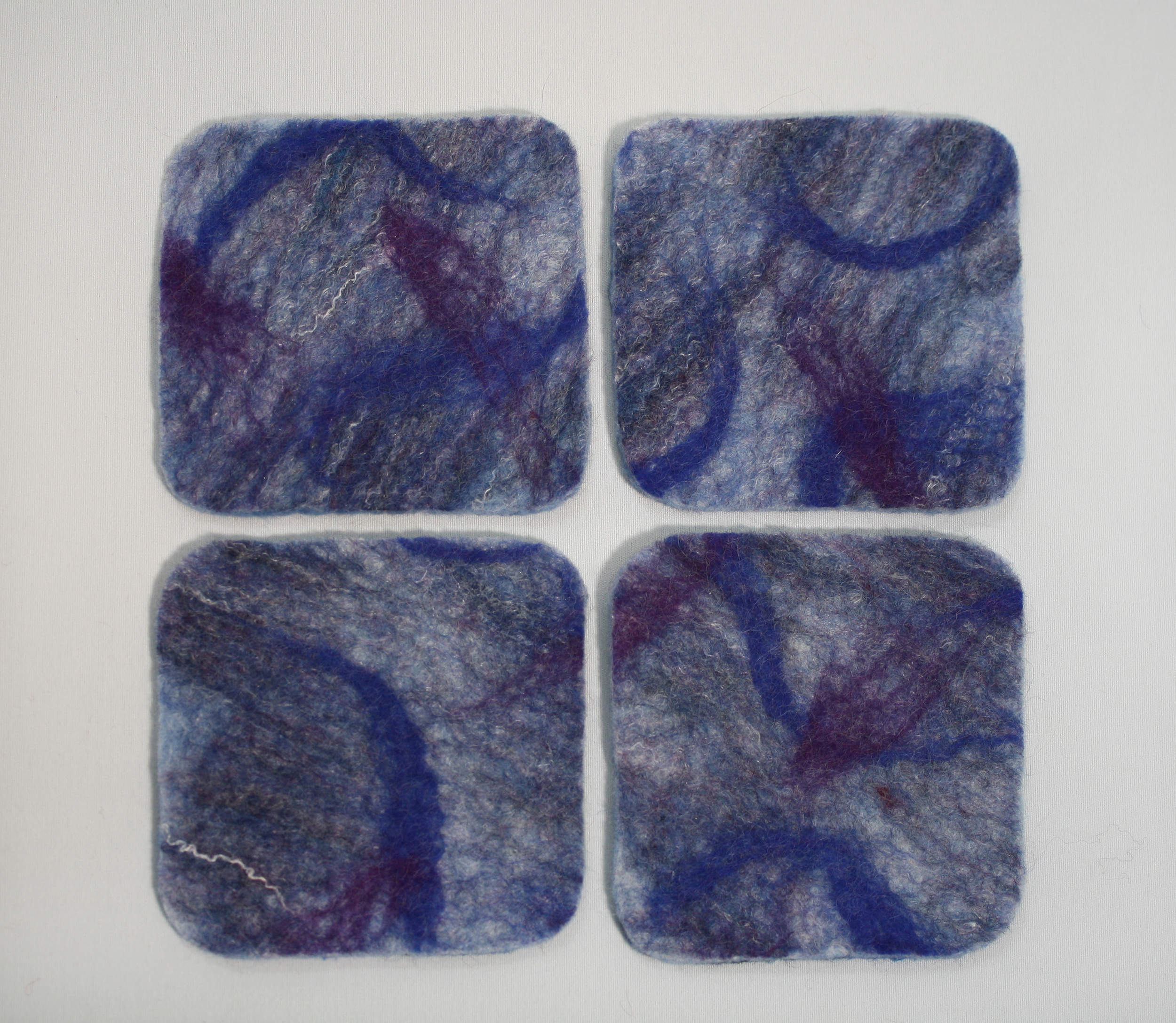 "Blue Lagoon coasters, 4.5"" square(ish), wet-felted of wool and silk fibres,  SOLD"